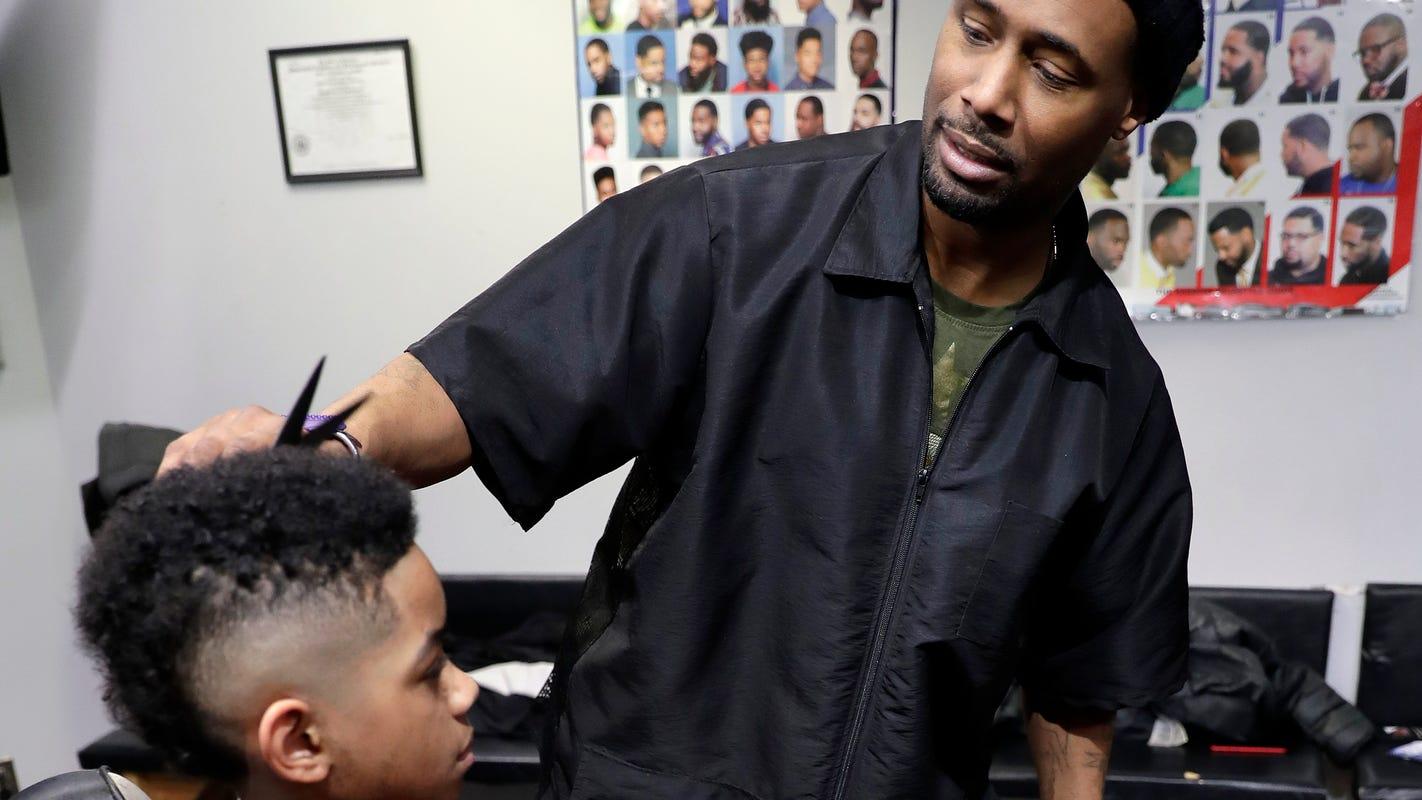 Black-owned barbershops create community in Wisconsin