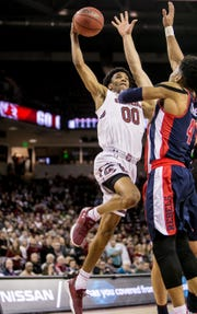 South Carolina guard A.J. Lawson (00) shoots over Mississippi guard Breein Tyree (4) in the first half Tuesday night at Colonial Life Arena in Columbia.