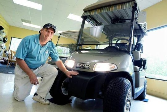 Bob Sutter, of Lowcountry Golf Cars, shows off an E-Z-GO golf cart equipped with headlights at the Okatie dealership. A bill passed a few years ago allowed golf cart driving after sunset if allowed by the municipality and if the cart is equipped with front and rear lights. For example, local laws allow for night driving on Daufuskie Island but not in the Town of Bluffton.