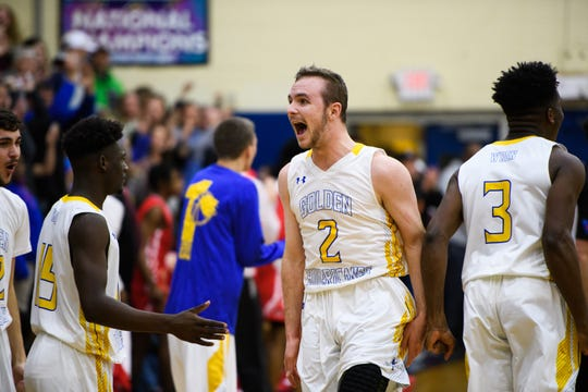 Wren's Ryan Ammons (2) celebrates with his teammates after beating Greenville 71-68 Tuesday, Feb. 19, 2019.