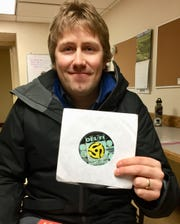 "Dave Martens of Havre holds his original 45 disc of  ""Hippy Hippy Shake"" by Robert Lee ""Chan"" Romero."