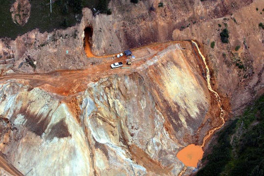 FILE - In this Aug. 11, 2015 aerial photo, wastewater streams out of the Gold King Mine in southwestern Colorado after a contractor crew led by the Environmental Protection Agency inadvertently triggered the release of about 3 million gallons of water tainted with heavy metals. Federal officials fear that at least six of the sites examined by The Associated Press could have blowouts like the one at Gold King. (Geoff Liesik/The Deseret News via AP, File)