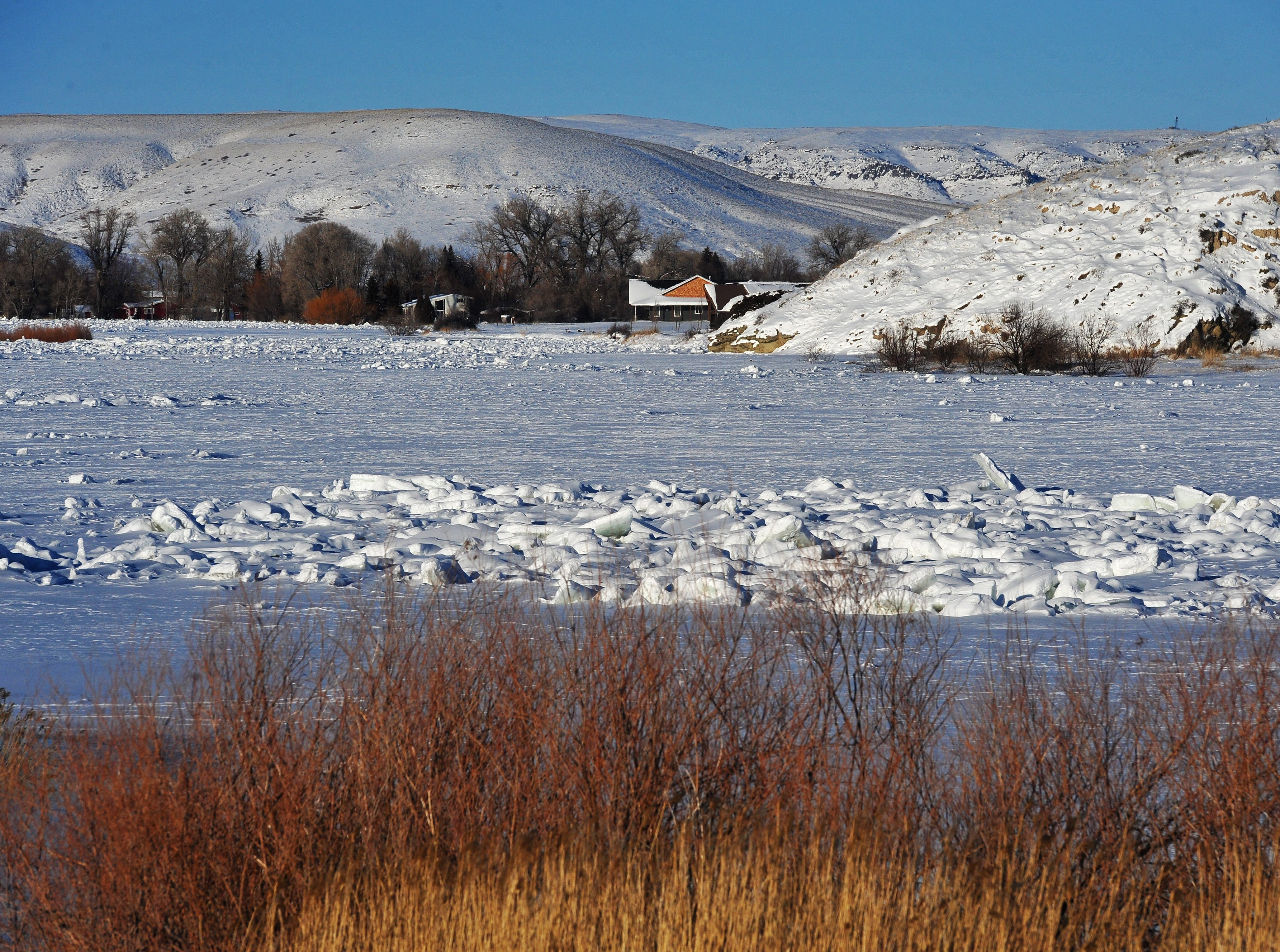Ice and snow cover completely hide the Missouri River at the Pelican Point fishing access site, Tuesday, February 19, 2019.  Ice jams along several miles of the Missouri River has caused minor flooding near Cascade.