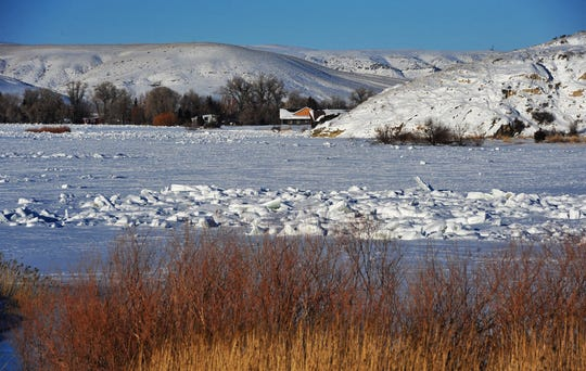 Ice and snow cover the Missouri River at the Pelican Point fishing access site Tuesday.
