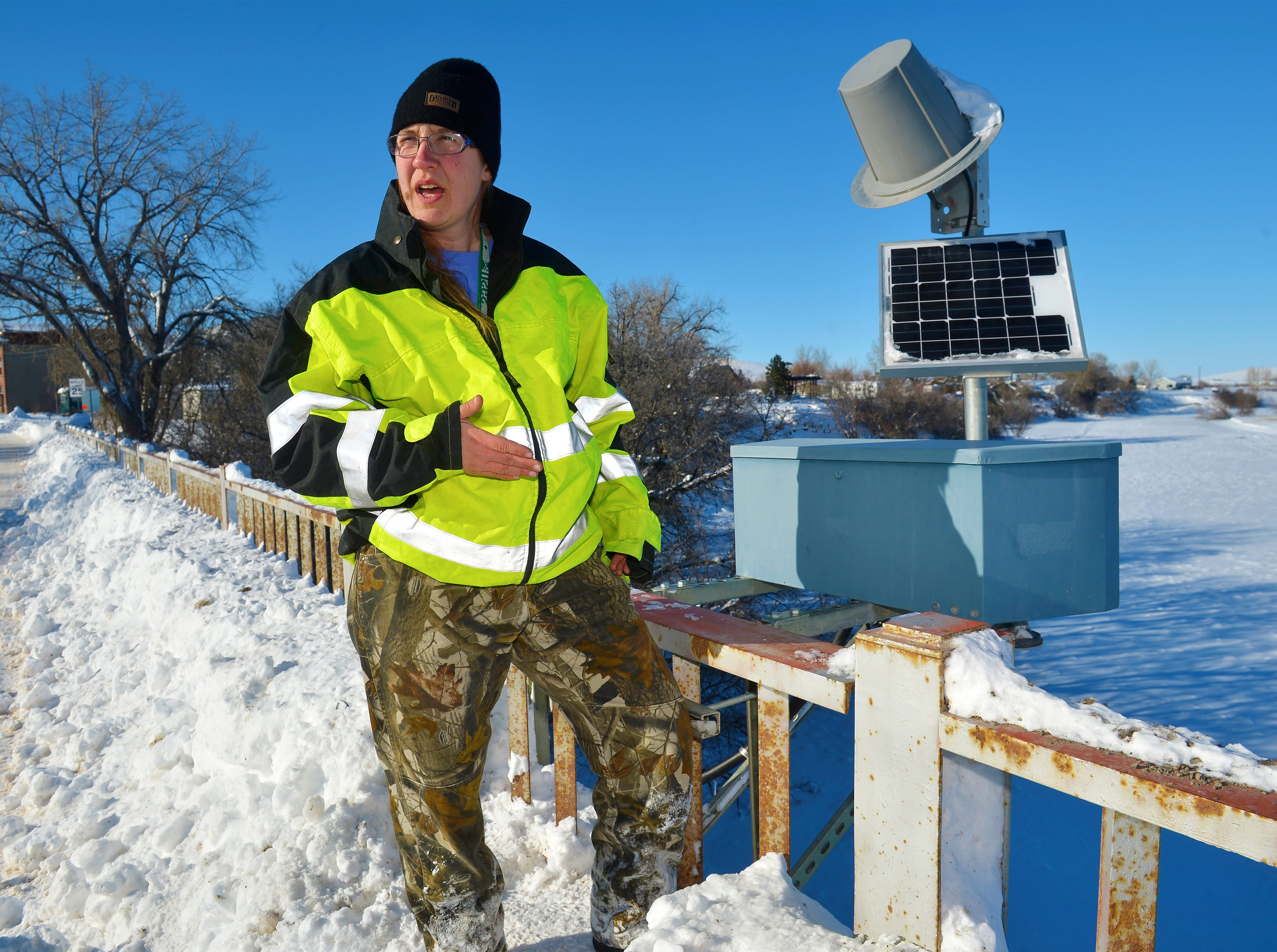 Kim Schierenbeck, a hydrologic technician with the U.S. Geologic Service, makes repairs to a river guage at a bridge on the Missouri River in Cascade on Tuesday afternoon. Ice jams along several miles of the Missouri River has caused minor flooding near Cascade.