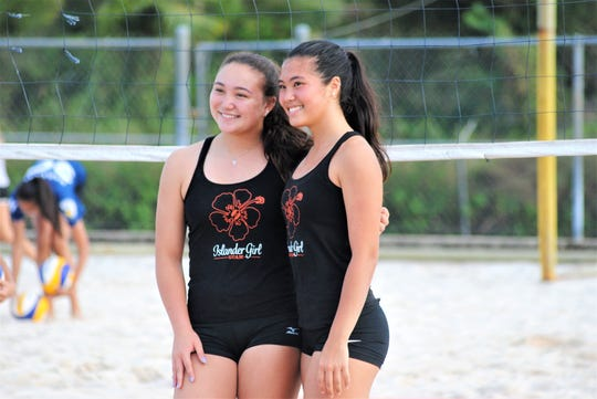 Tylee Shepherd, left and Hallie Wigsten are unbeaten in the exhibition season of IIAAG Beach Volleyball. The two are a big reason why St. John's White remains undefeated at 4-0 in the four-team league.