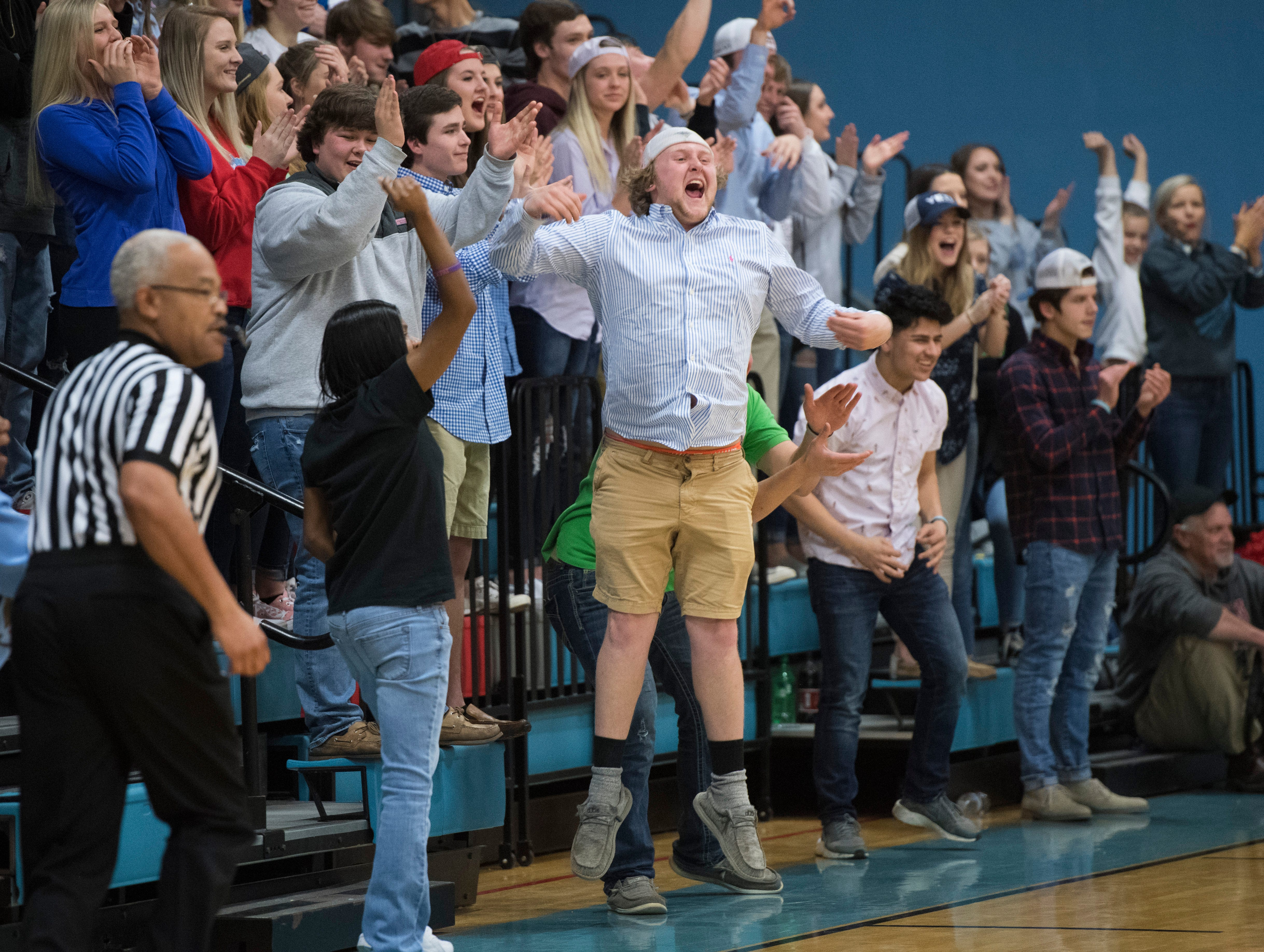 The Union County Braves student sections erupts during the Union County vs Webster County game at the Dr.Doug Hines Gymnasium in Morganfield, Ky. Tuesday, Feb. 19, 2019.