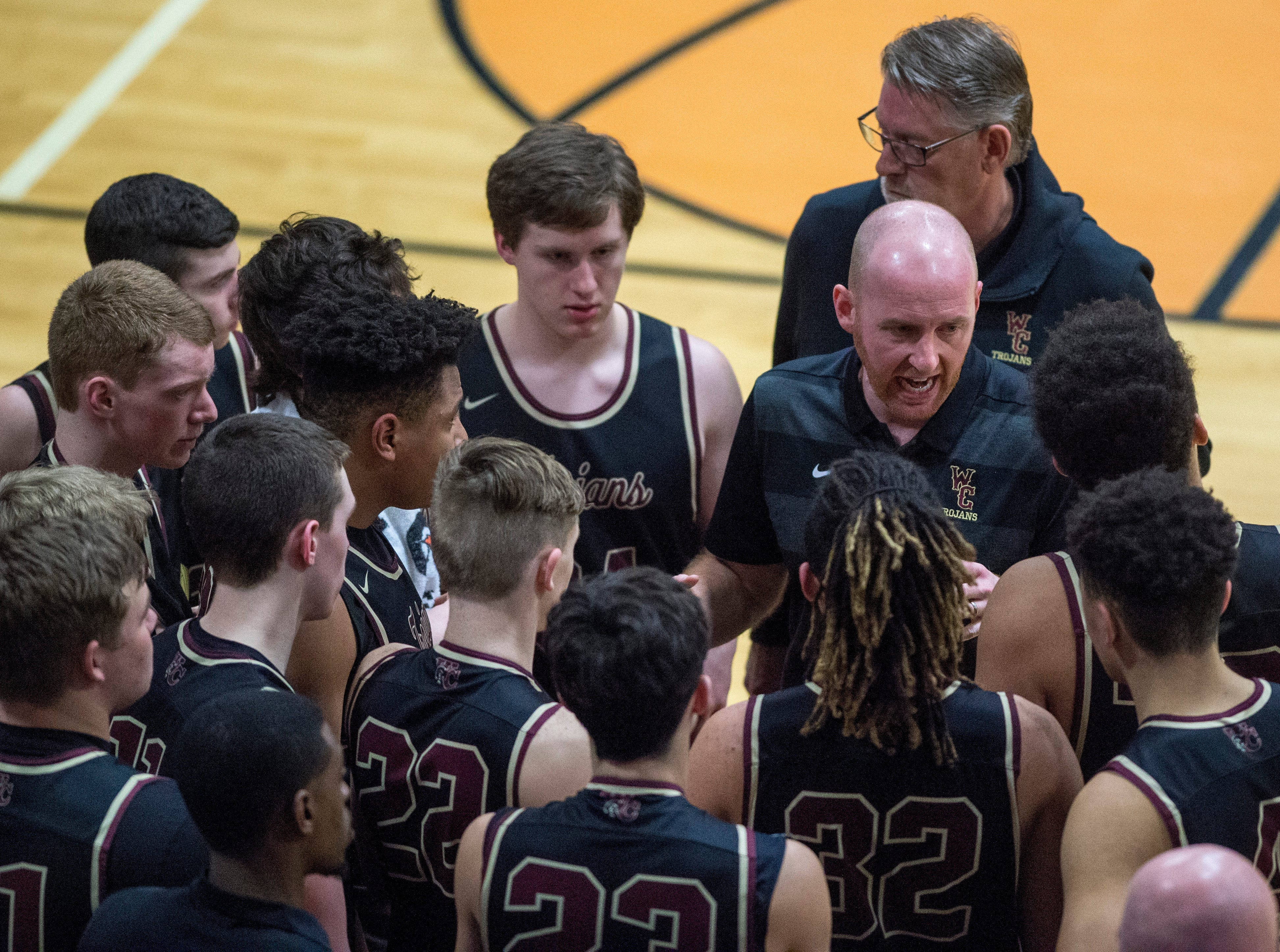 Webster County's Head Coach Jon Newton gathers his team before the start of the third period during the Union County vs Webster County game at the Dr. Doug Hines Gymnasium in Morganfield, Ky. Tuesday, Feb. 19, 2019.