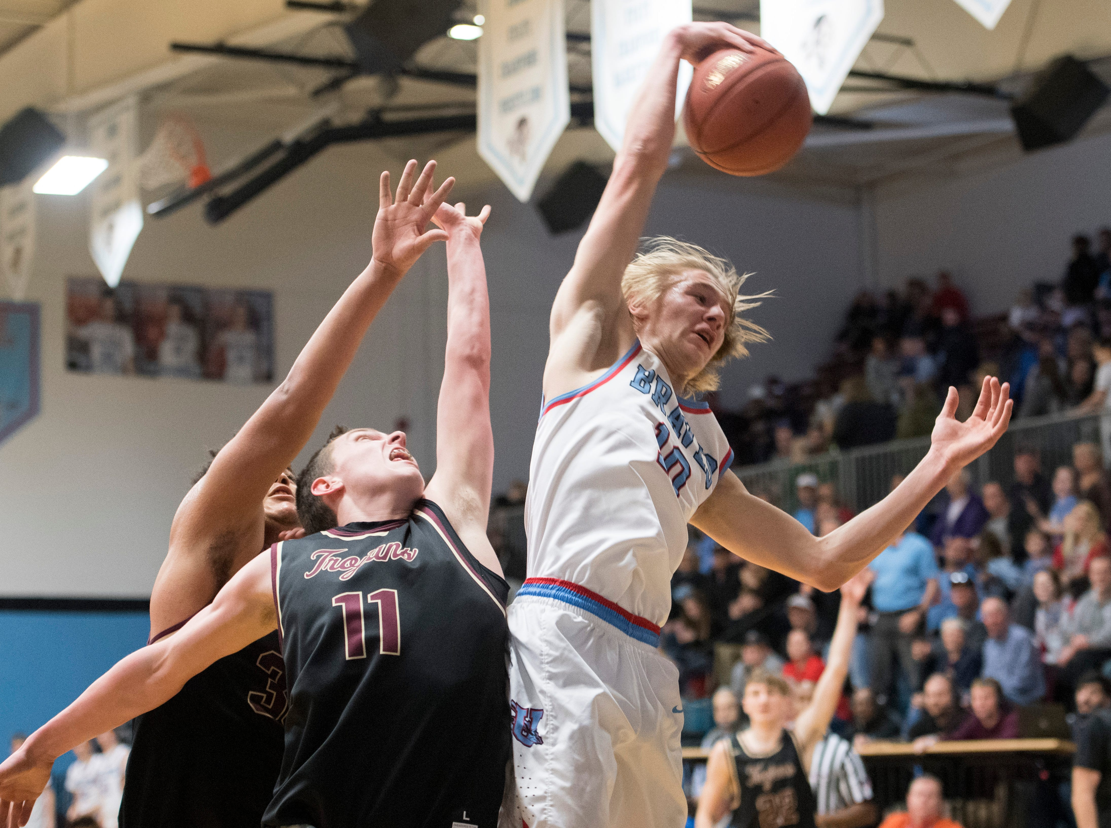 Union County's Cade Duncan (10) grabs a rebound during the Union County vs Webster County game at the Dr. Doug Hines Gymnasium in Morganfield, Ky. Tuesday, Feb. 19, 2019.
