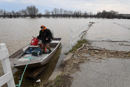 Ted Mueller lands his johnboat on the levee surrounding Ellis Park Tuesday. Mueller lives in one of the river camps along the river and needed to go to town for fuel and repair parts for his generator, February 19, 2019.