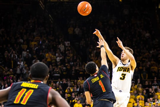 Iowa guard Jordan Bohannon puts up a last-second 3-point attempt against Maryland's Anthony Cowan on Tuesday. Bohannon's shot fell off the rim and the Hawkeyes lost 66-65 at Carver-Hawkeye Arena.
