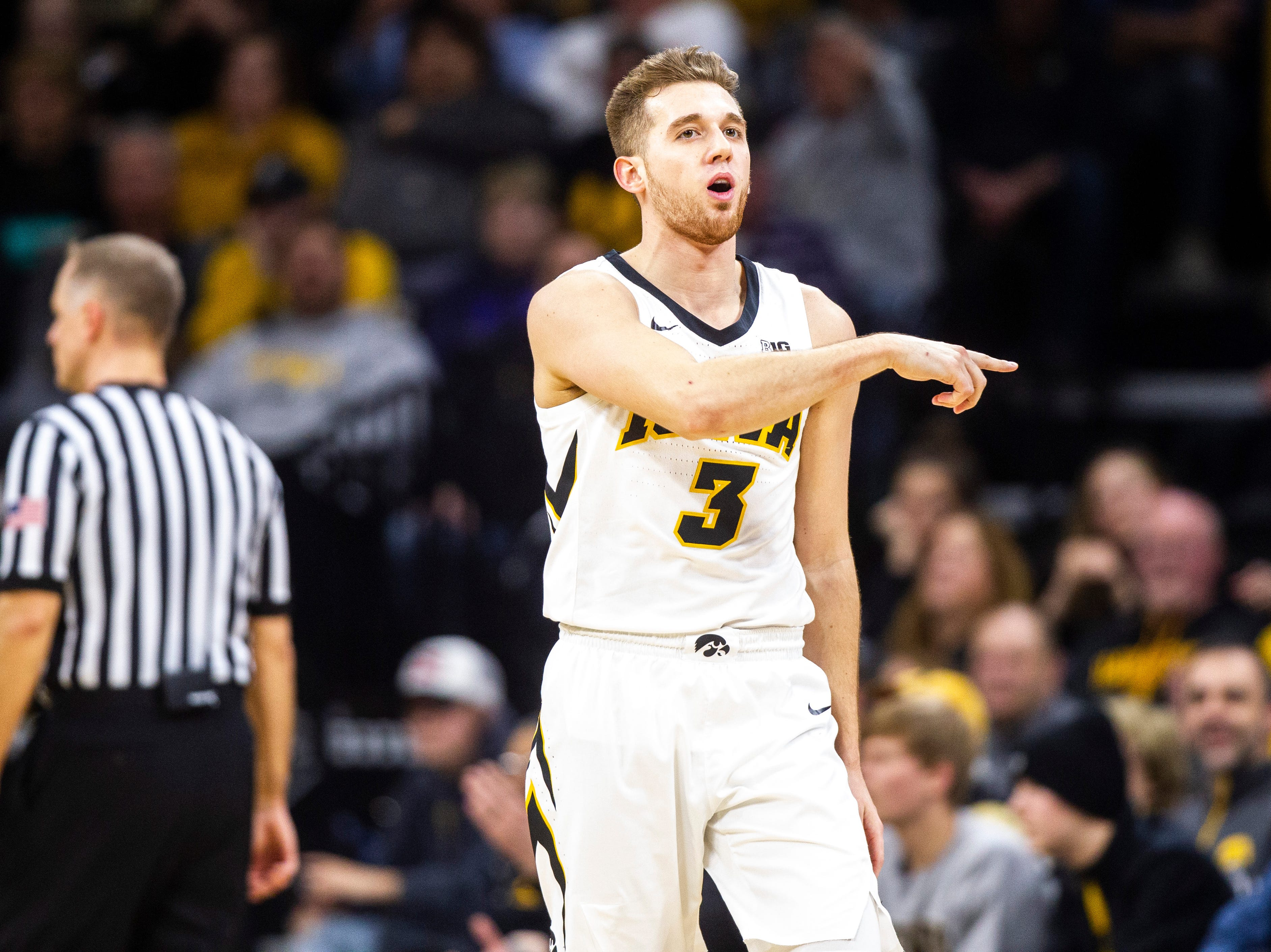 Iowa guard Jordan Bohannon (3) reacts after getting called for a foul during a NCAA Big Ten Conference men's basketball game on Tuesday, Feb. 19, 2019 at Carver-Hawkeye Arena in Iowa City, Iowa.