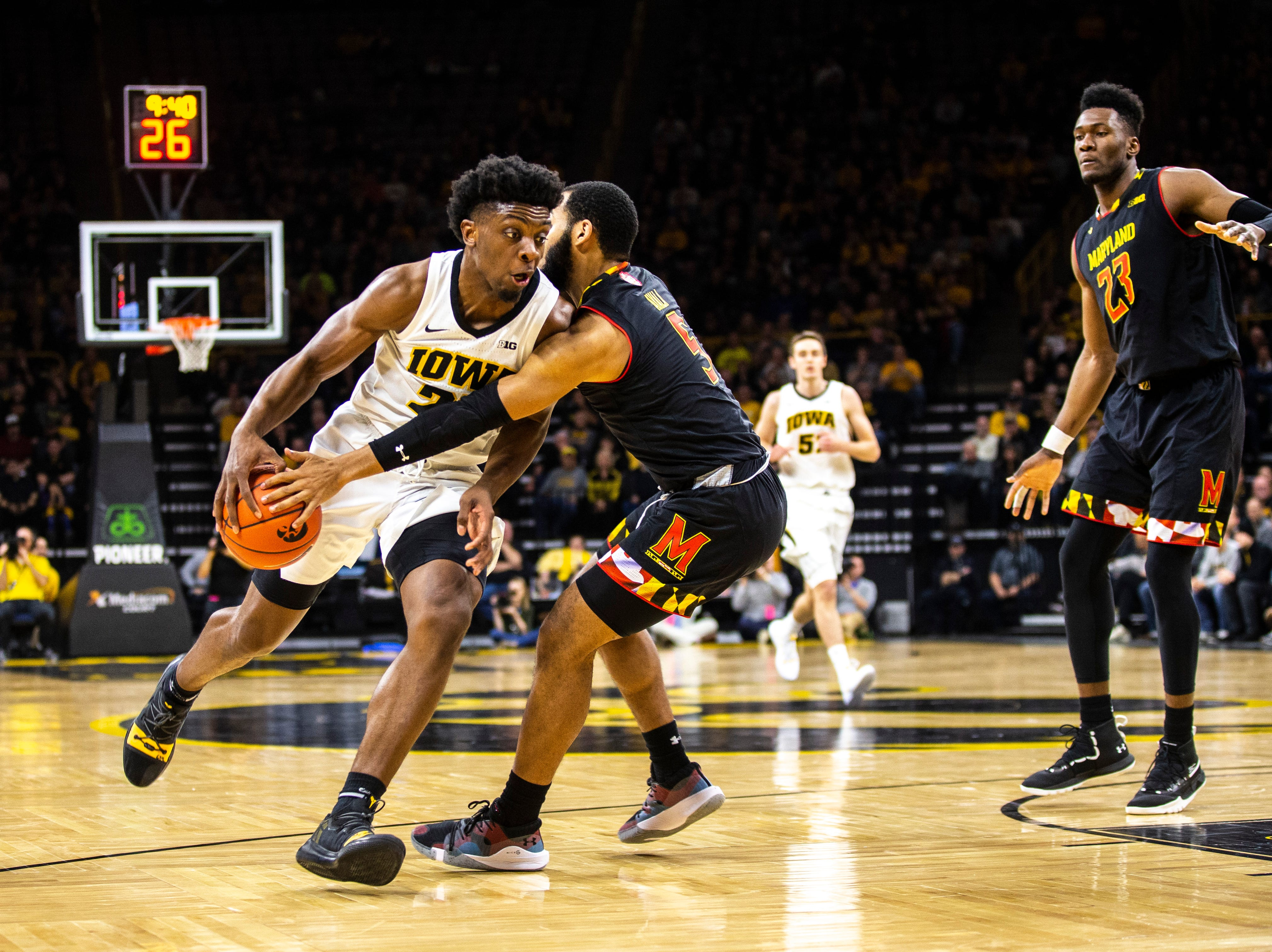Iowa forward Tyler Cook (25) drives to the basket while Maryland guard Eric Ayala (5) defends during a NCAA Big Ten Conference men's basketball game on Tuesday, Feb. 19, 2019 at Carver-Hawkeye Arena in Iowa City, Iowa.