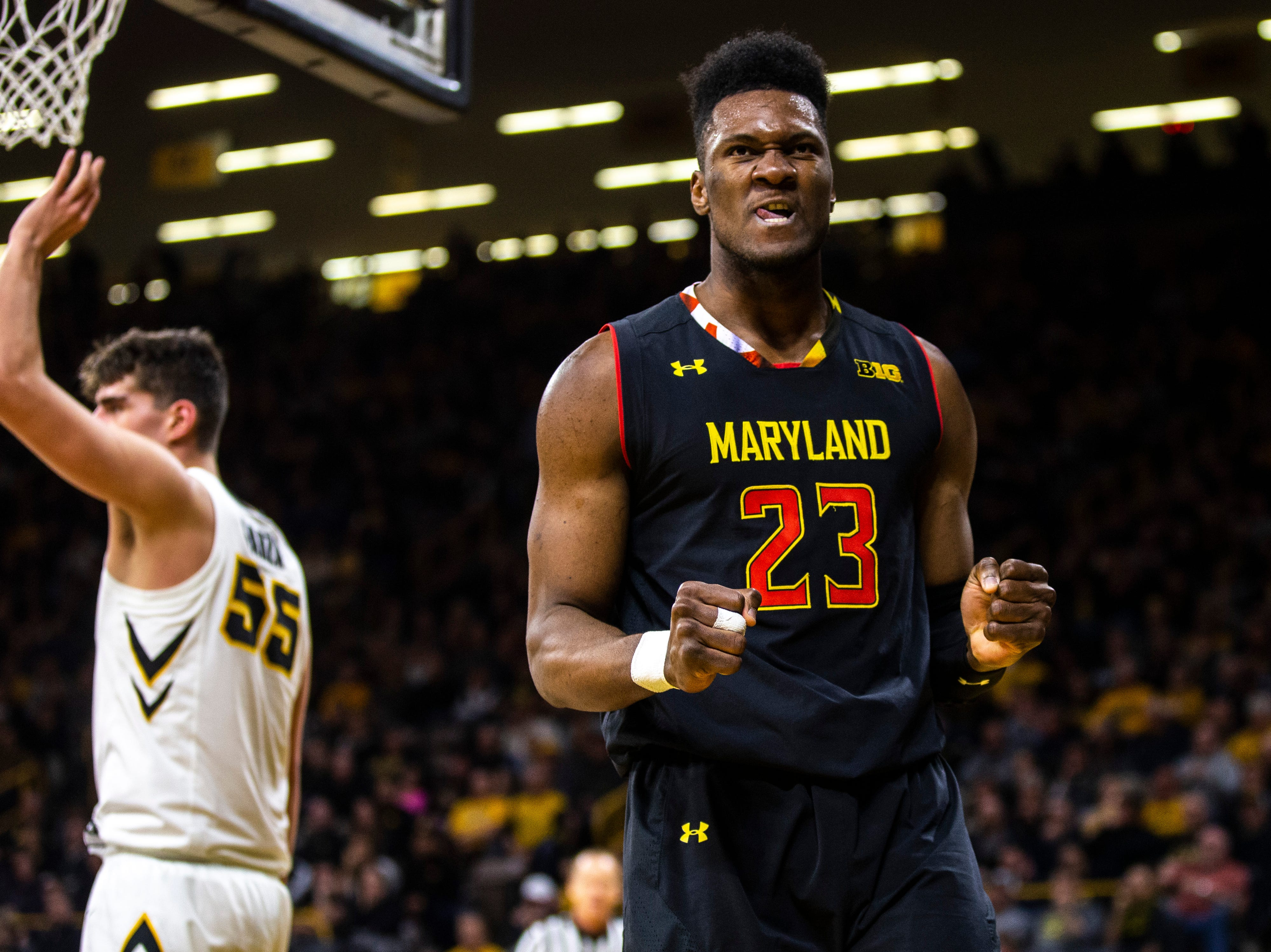 Maryland forward Bruno Fernando (23) reacts after drawing a foul from Iowa center Luka Garza (55) during a NCAA Big Ten Conference men's basketball game on Tuesday, Feb. 19, 2019 at Carver-Hawkeye Arena in Iowa City, Iowa.
