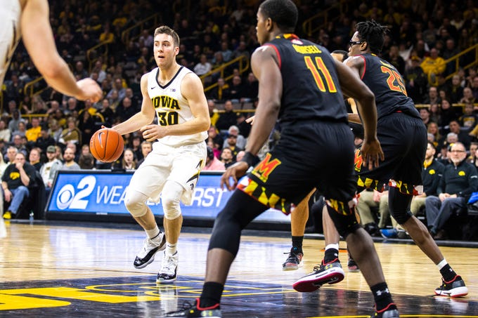 Iowa guard Connor McCaffery (30) drives to the basket while Maryland forward Jalen Smith (25) and Maryland guard Darryl Morsell (11) defend during a NCAA Big Ten Conference men's basketball game on Tuesday, Feb. 19, 2019 at Carver-Hawkeye Arena in Iowa City, Iowa.
