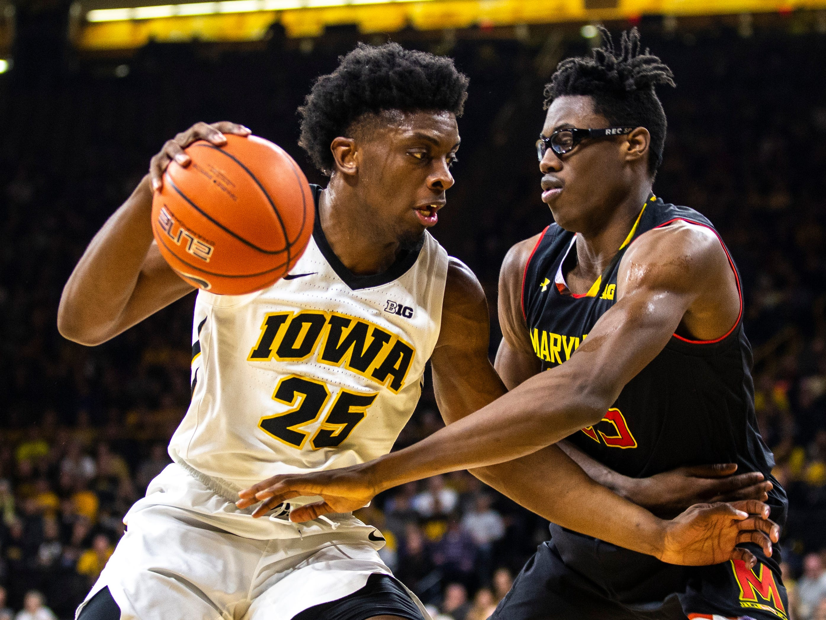 Iowa forward Tyler Cook (25) drives to the basket while Maryland forward Jalen Smith, right, defends during a NCAA Big Ten Conference men's basketball game on Tuesday, Feb. 19, 2019 at Carver-Hawkeye Arena in Iowa City, Iowa.