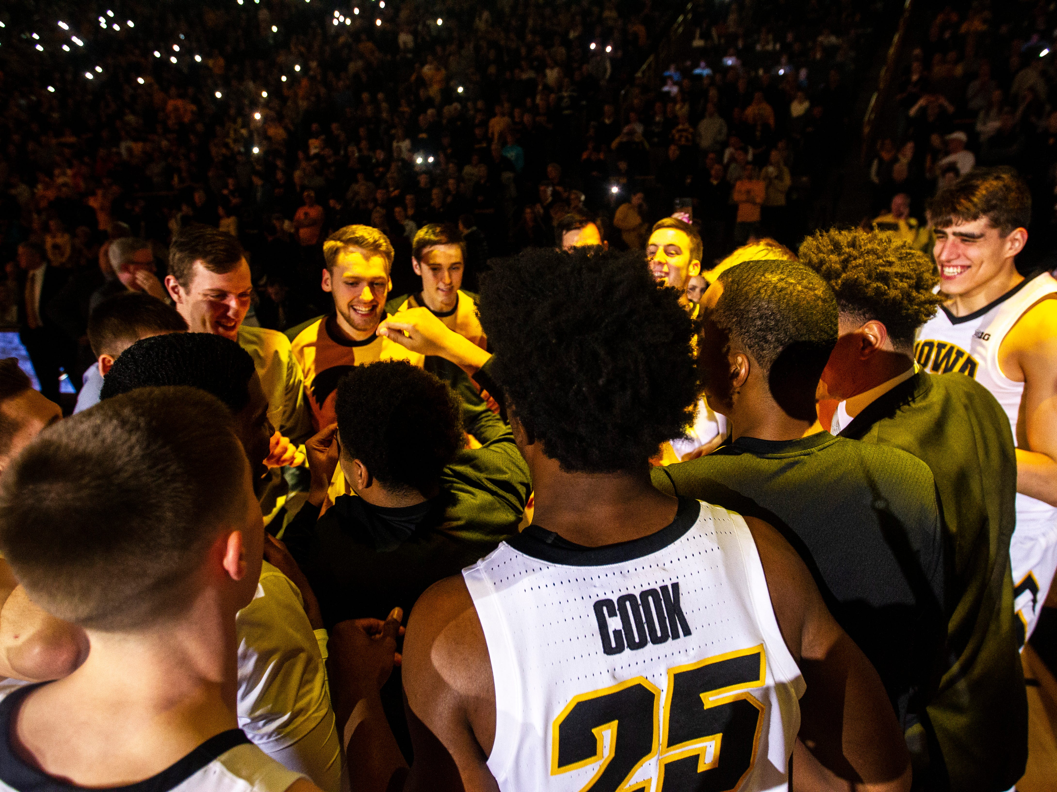 Iowa Hawkeyes players huddle up after introductions during a NCAA Big Ten Conference men's basketball game on Tuesday, Feb. 19, 2019 at Carver-Hawkeye Arena in Iowa City, Iowa.