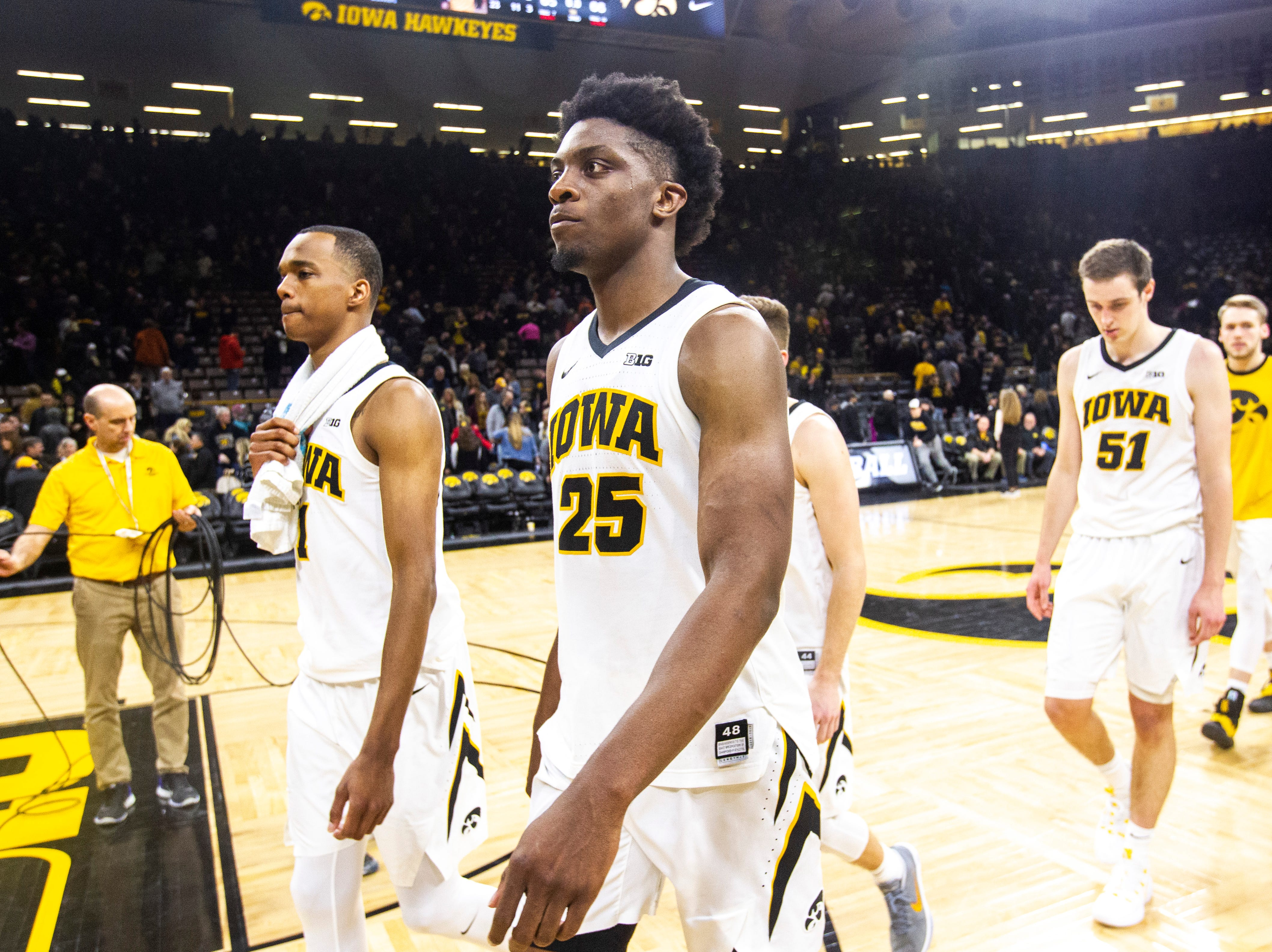 Iowa guard Maishe Dailey (1) Iowa forward Tyler Cook (25) and Iowa forward Nicholas Baer (51) walk off the court after a NCAA Big Ten Conference men's basketball game against Maryland on Tuesday, Feb. 19, 2019 at Carver-Hawkeye Arena in Iowa City, Iowa.