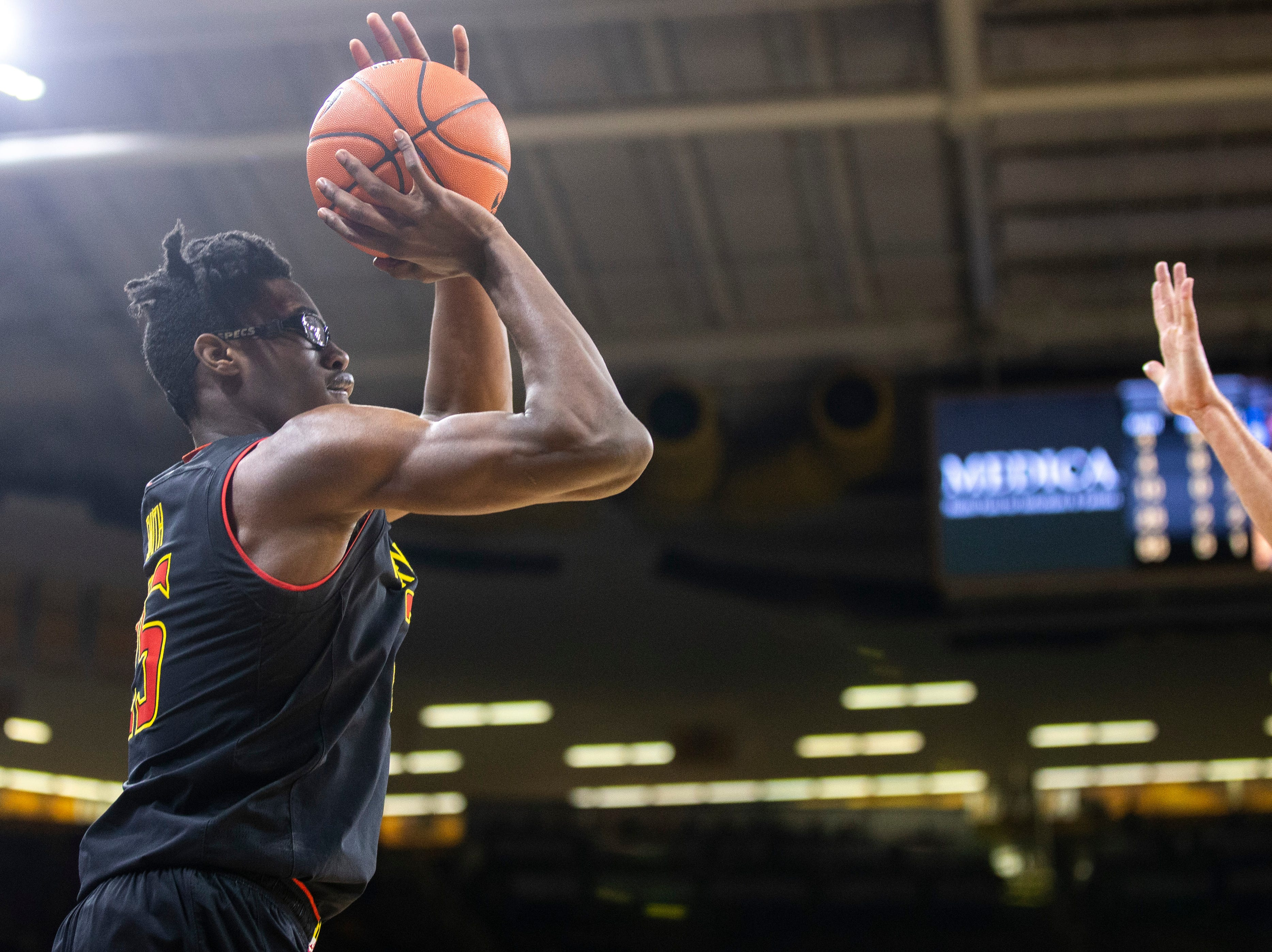 Maryland forward Jalen Smith (25) shoots a 3-point basket during a NCAA Big Ten Conference men's basketball game on Tuesday, Feb. 19, 2019 at Carver-Hawkeye Arena in Iowa City, Iowa.