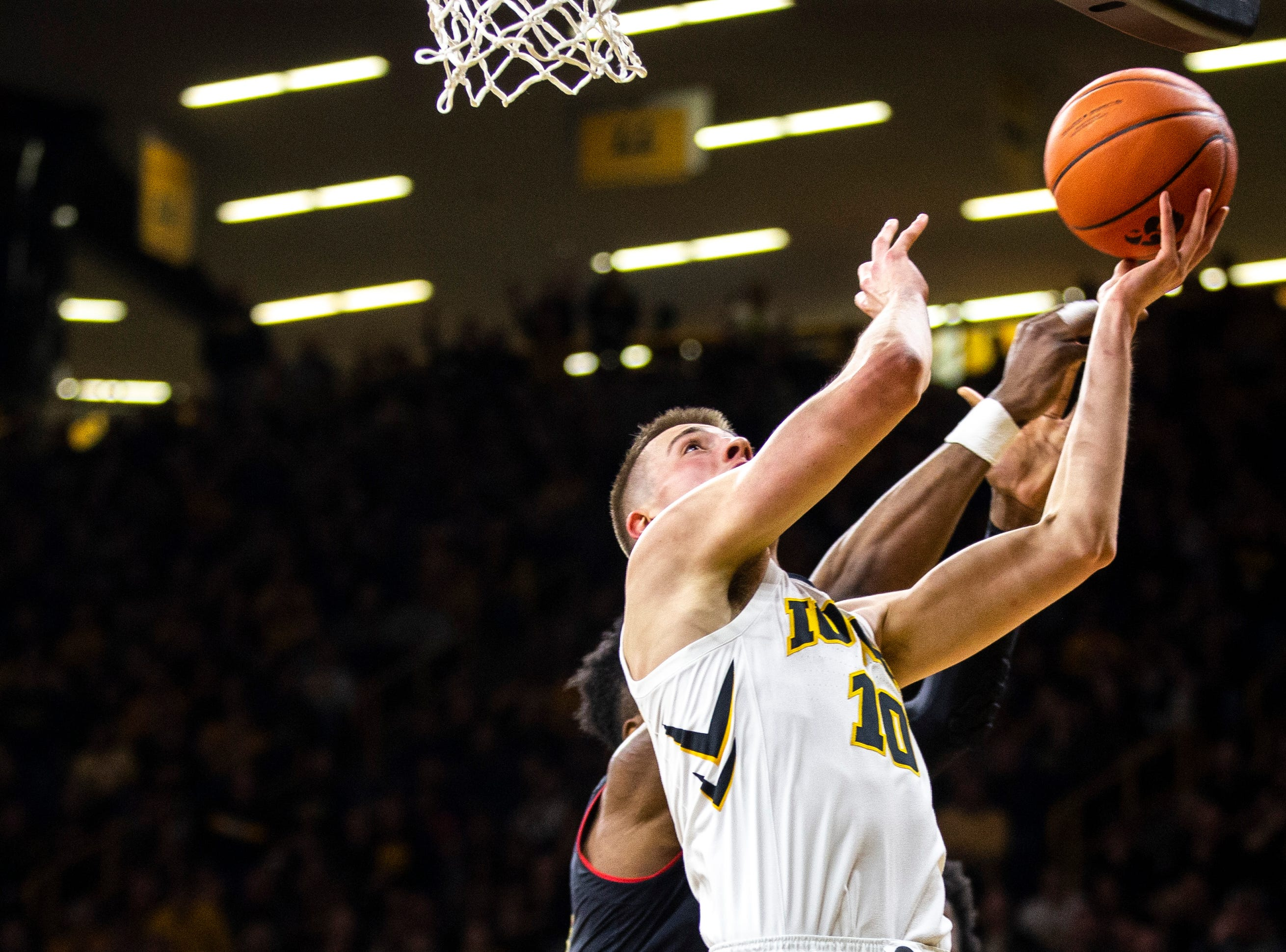 Iowa guard Joe Wieskamp (10) attempts a basket during a NCAA Big Ten Conference men's basketball game on Tuesday, Feb. 19, 2019 at Carver-Hawkeye Arena in Iowa City, Iowa.