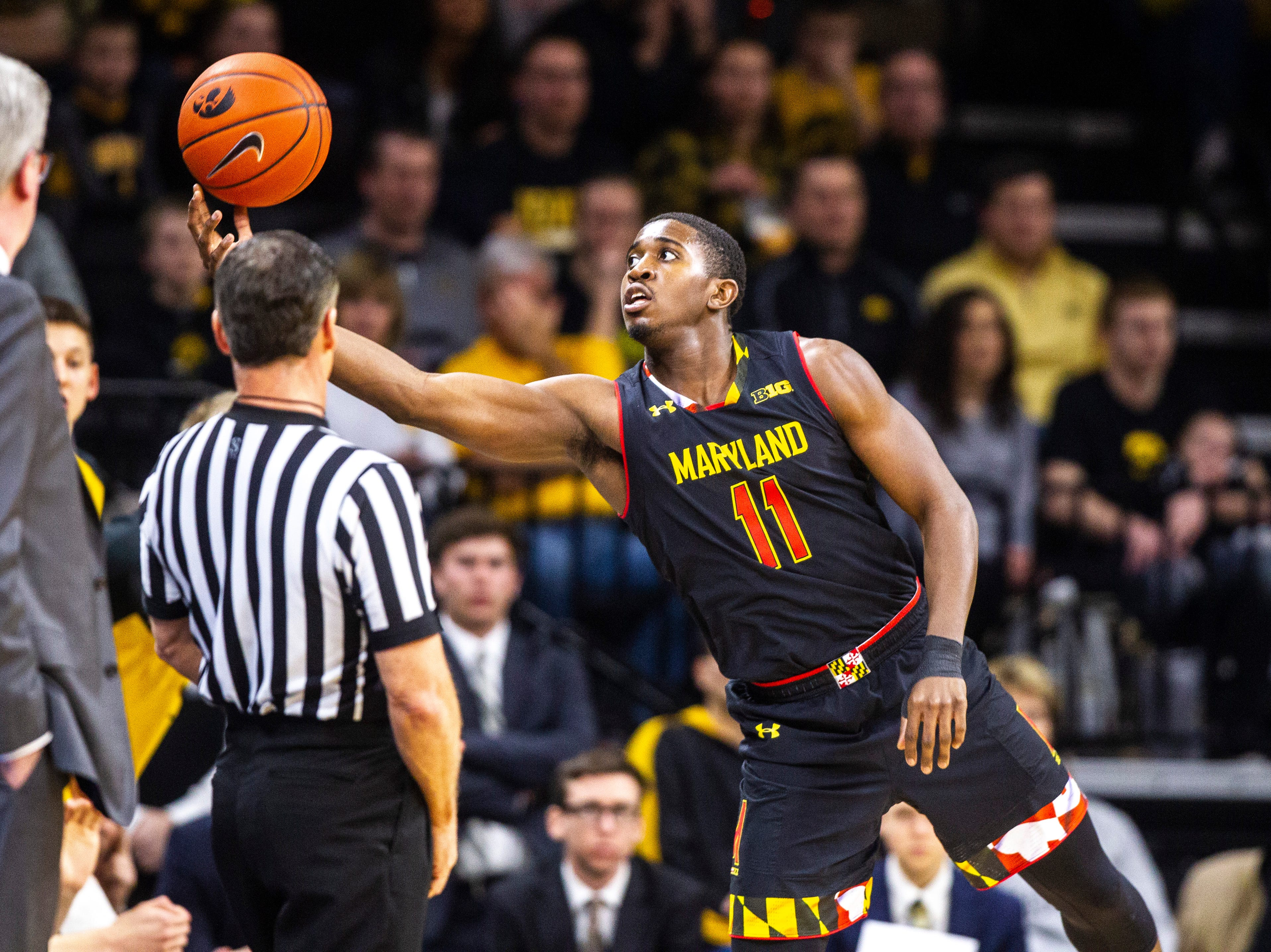 Maryland guard Darryl Morsell (11) saves a pass during a NCAA Big Ten Conference men's basketball game on Tuesday, Feb. 19, 2019 at Carver-Hawkeye Arena in Iowa City, Iowa.