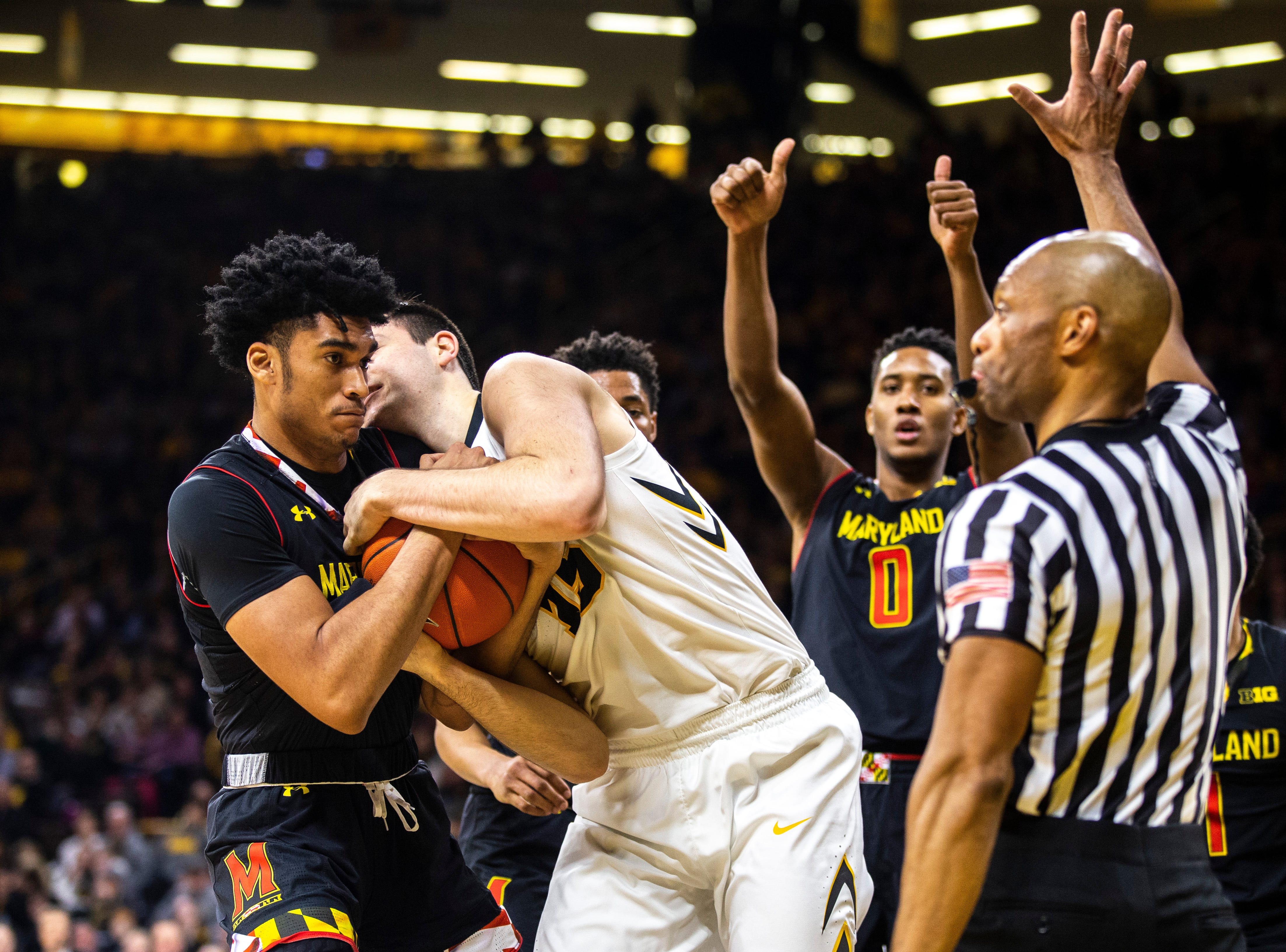 Iowa forward Ryan Kriener (15) battles for a jump ball against Maryland forward Ricky Lindo Jr. (14) during a NCAA Big Ten Conference men's basketball game on Tuesday, Feb. 19, 2019 at Carver-Hawkeye Arena in Iowa City, Iowa.