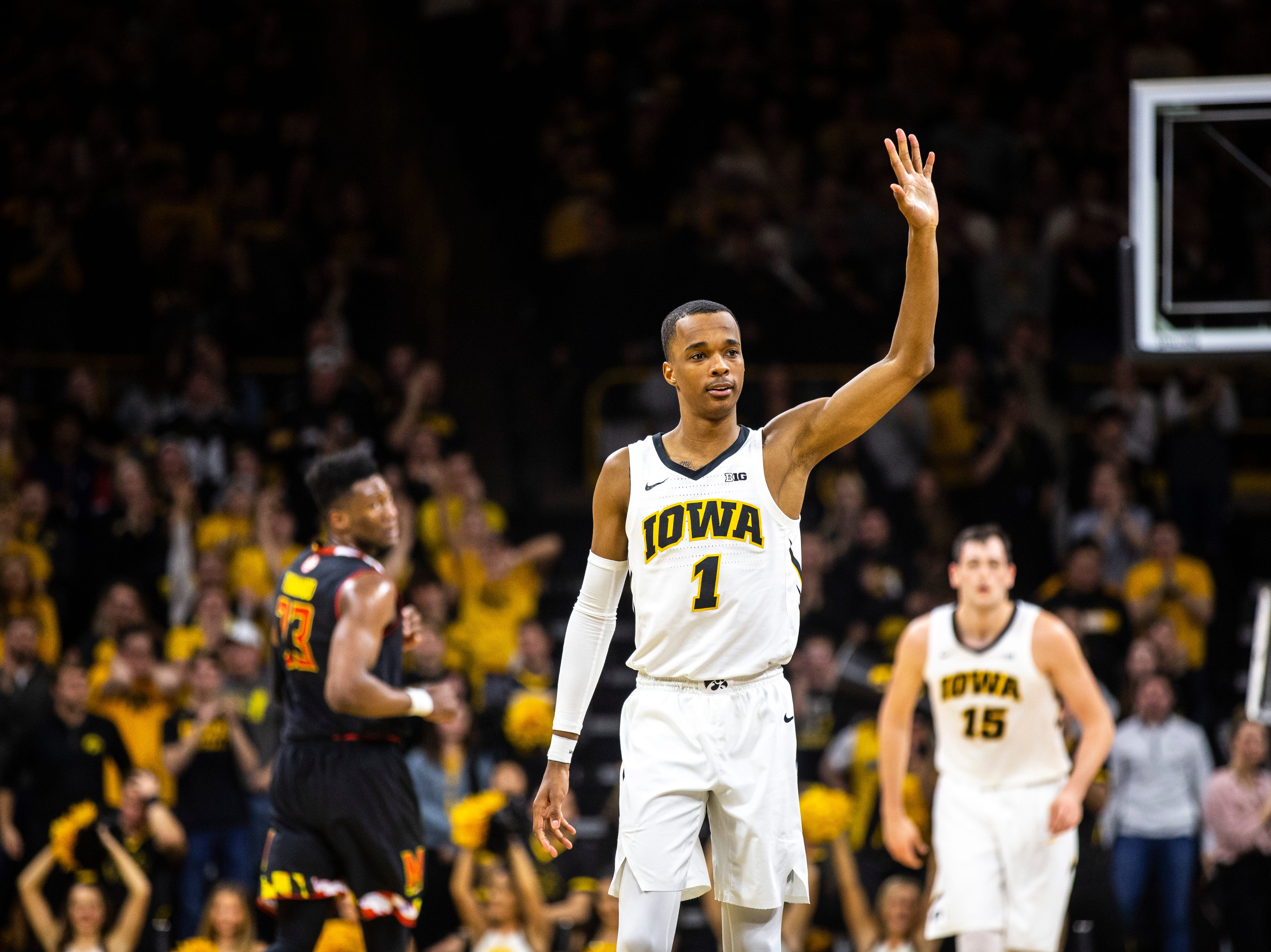 Iowa guard Maishe Dailey gestures to teammates while settling in on defense during a NCAA Big Ten Conference men's basketball game on Tuesday, Feb. 19, 2019 at Carver-Hawkeye Arena in Iowa City, Iowa.