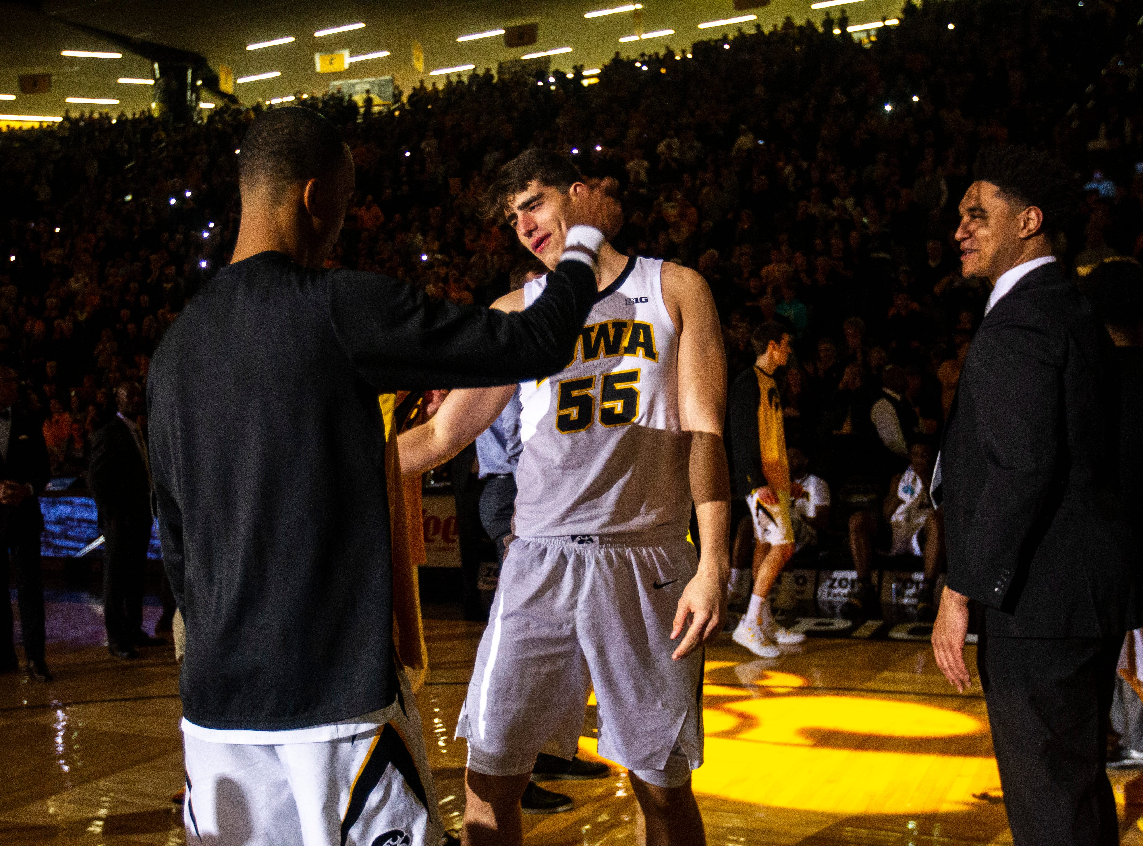 Iowa center Luka Garza (55) high-fives Iowa guard Maishe Dailey while being introduced during a NCAA Big Ten Conference men's basketball game on Tuesday, Feb. 19, 2019 at Carver-Hawkeye Arena in Iowa City, Iowa.