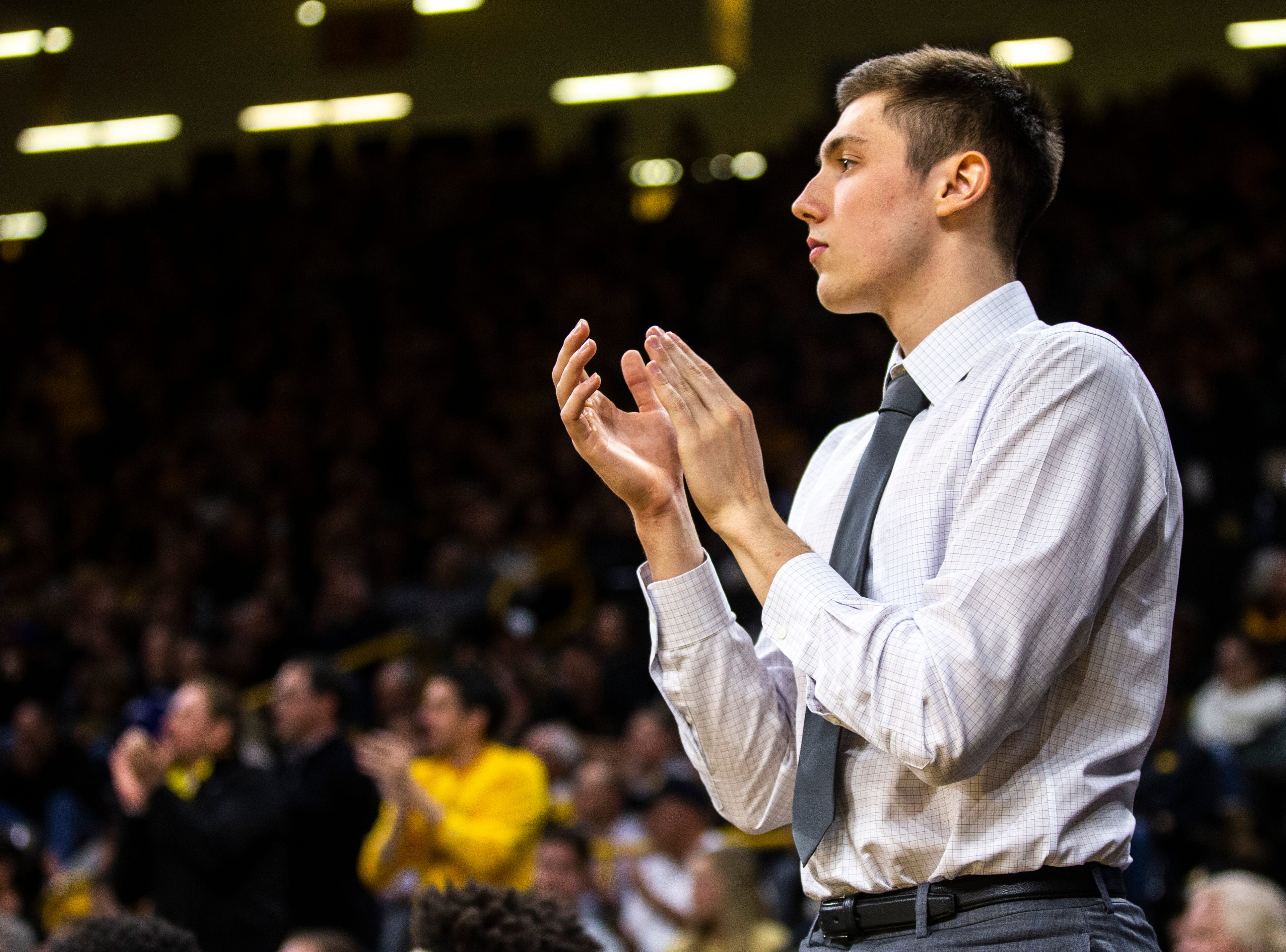 Iowa guard C.J. Fredrick claps during a NCAA Big Ten Conference men's basketball game on Tuesday, Feb. 19, 2019 at Carver-Hawkeye Arena in Iowa City, Iowa.
