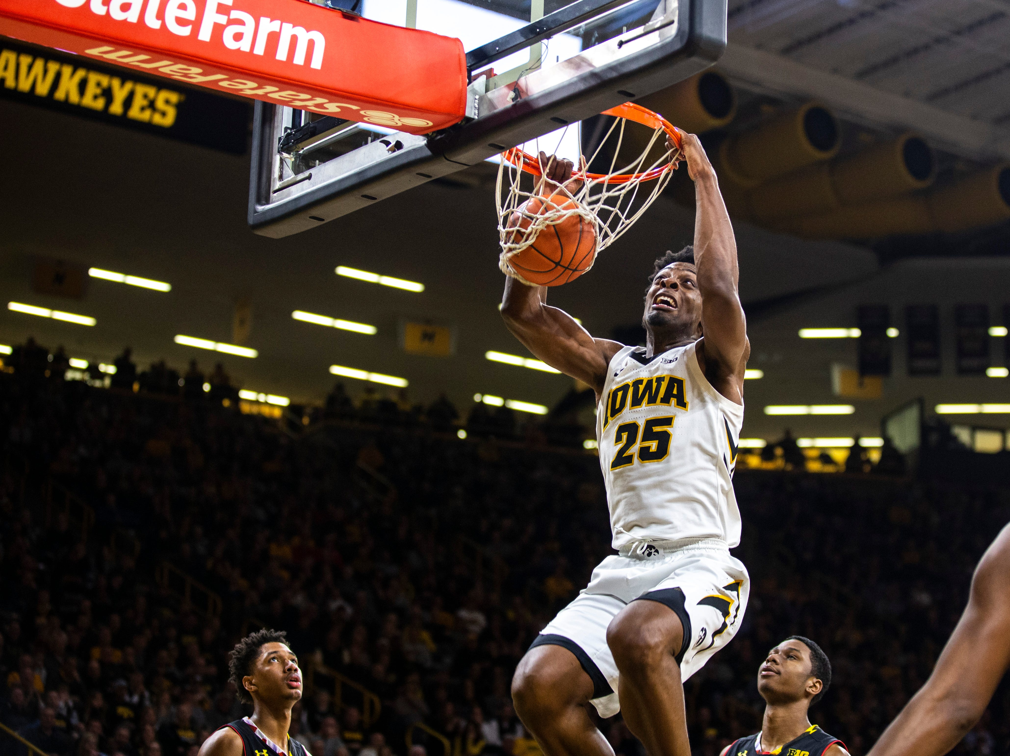 Iowa forward Tyler Cook (25) dunks during a NCAA Big Ten Conference men's basketball game on Tuesday, Feb. 19, 2019 at Carver-Hawkeye Arena in Iowa City, Iowa.