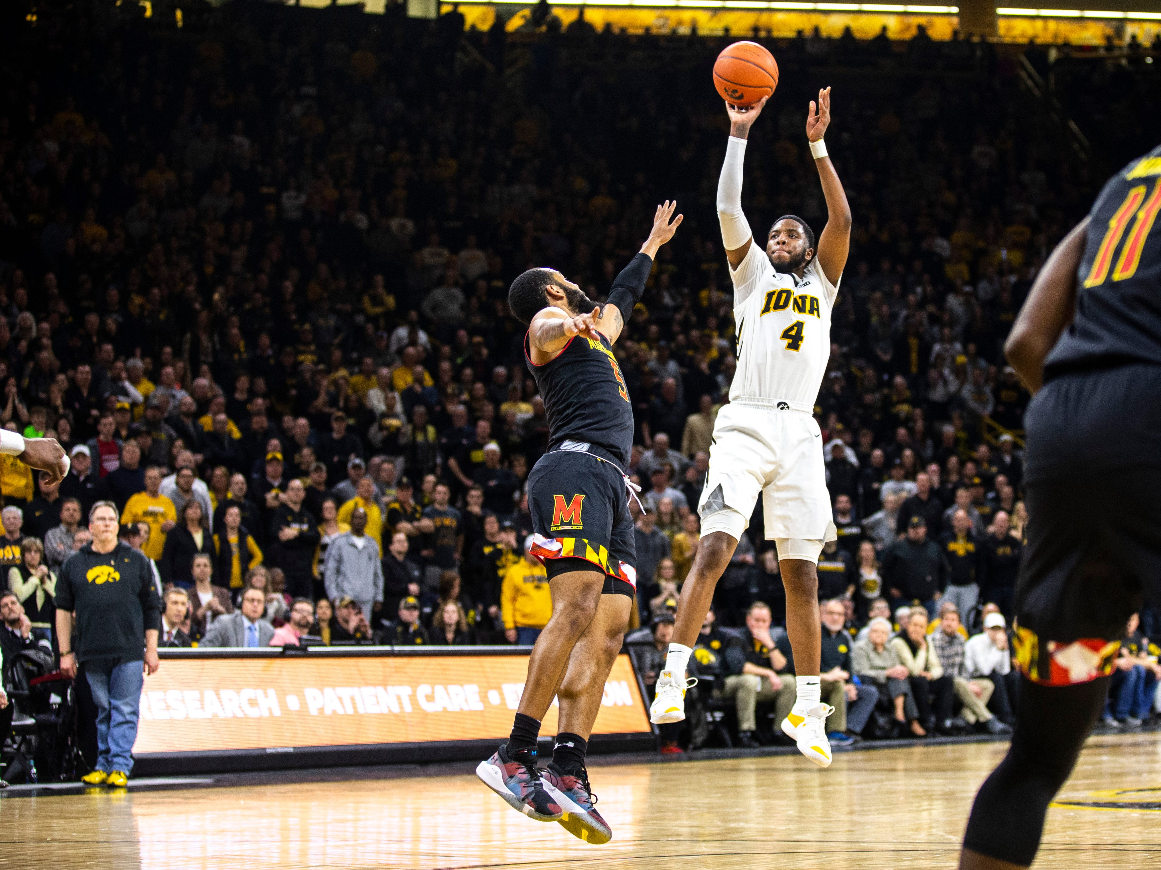Iowa guard Isaiah Moss (4) attempts a 3-point basket while Maryland guard Eric Ayala (5) defends during a NCAA Big Ten Conference men's basketball game on Tuesday, Feb. 19, 2019 at Carver-Hawkeye Arena in Iowa City, Iowa.