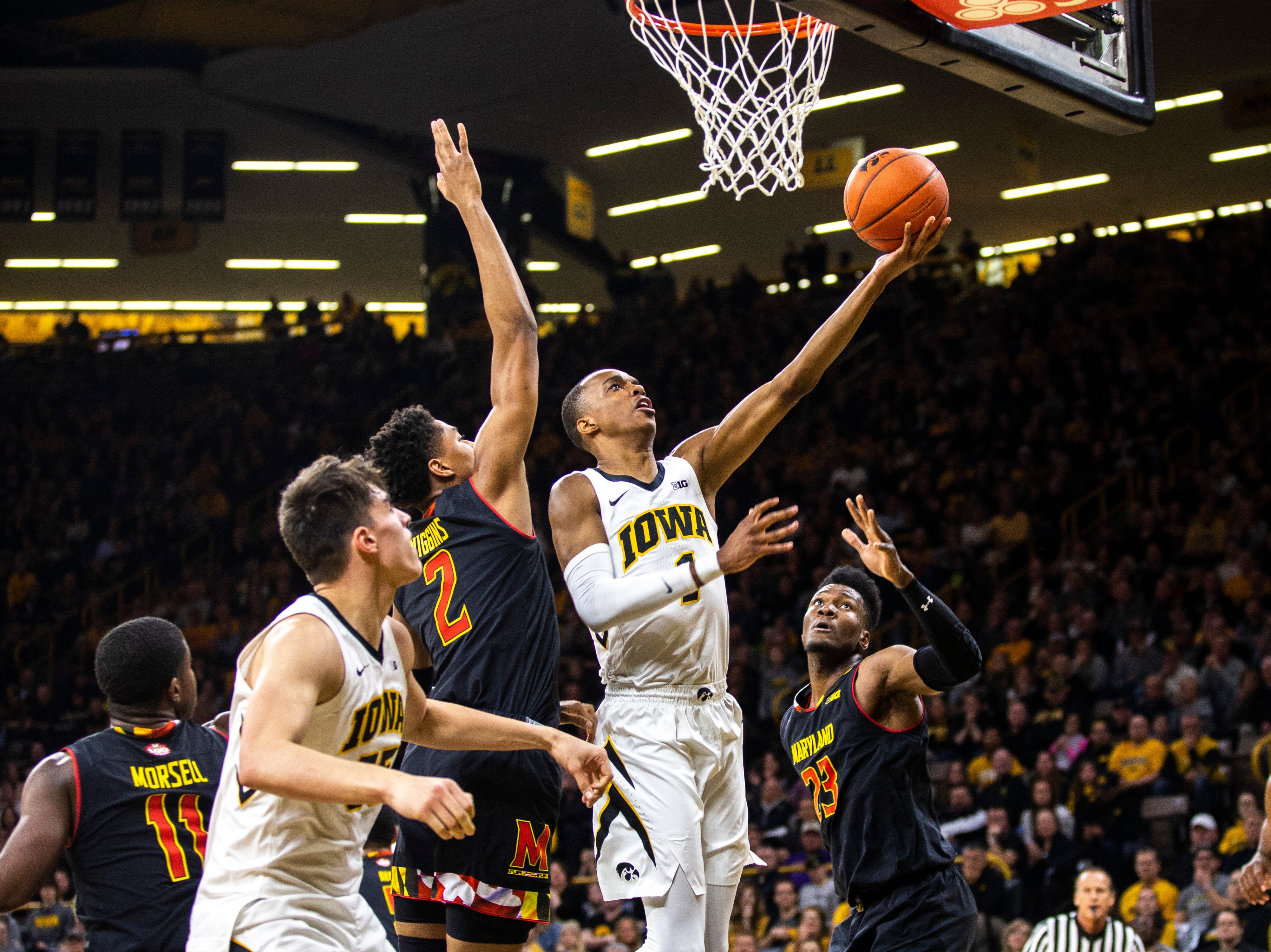 Iowa guard Maishe Dailey (1) makes a basket while Maryland guard Aaron Wiggins (2) defends during a NCAA Big Ten Conference men's basketball game on Tuesday, Feb. 19, 2019 at Carver-Hawkeye Arena in Iowa City, Iowa.