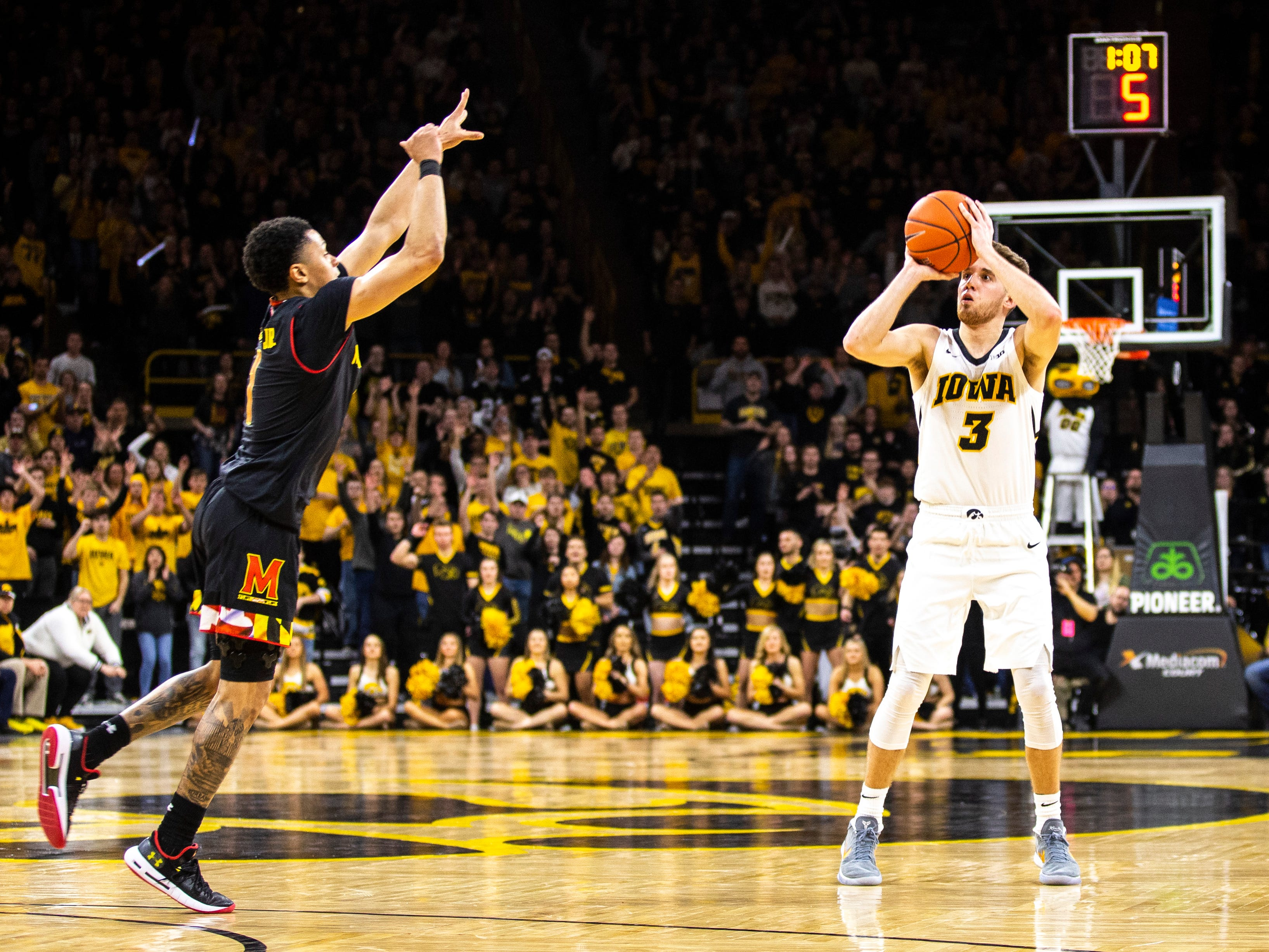Iowa guard Jordan Bohannon (3) attempts a 3-point basket while Maryland guard Anthony Cowan Jr. (1) defends during a NCAA Big Ten Conference men's basketball game on Tuesday, Feb. 19, 2019 at Carver-Hawkeye Arena in Iowa City, Iowa.