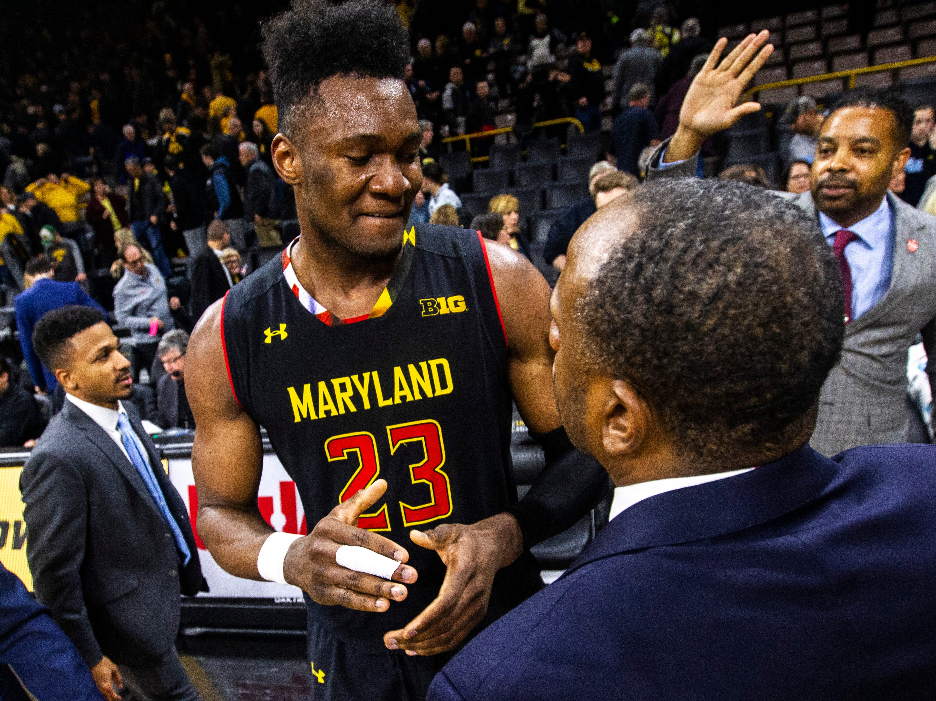 Maryland forward Bruno Fernando (23) celebrates with coaches after a NCAA Big Ten Conference men's basketball game against the Iowa Hawkeyes on Tuesday, Feb. 19, 2019 at Carver-Hawkeye Arena in Iowa City, Iowa.
