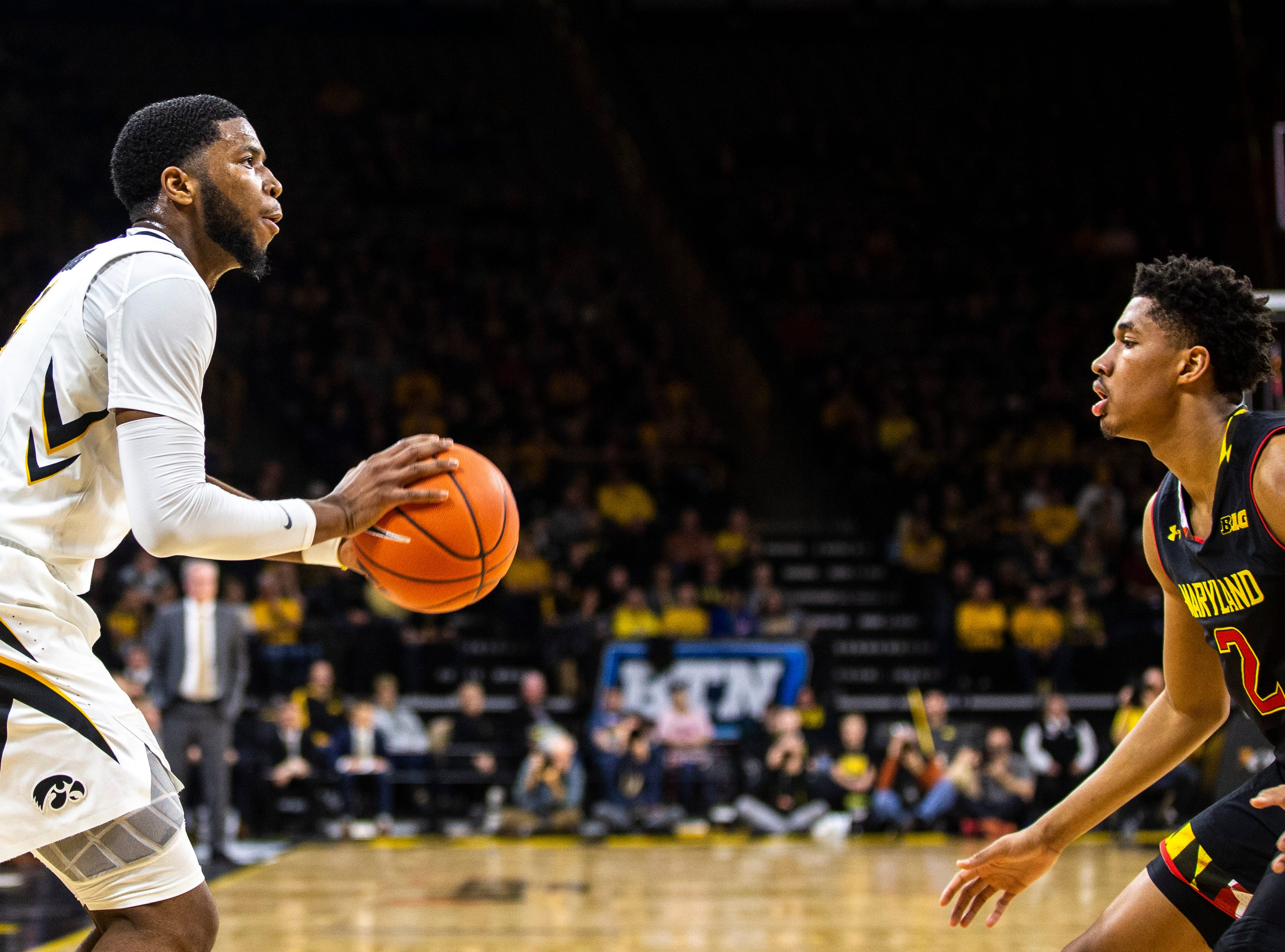 Iowa guard Isaiah Moss (4) rises to shoot a 3-point basket while Maryland guard Aaron Wiggins (2) defends during a NCAA Big Ten Conference men's basketball game on Tuesday, Feb. 19, 2019 at Carver-Hawkeye Arena in Iowa City, Iowa.