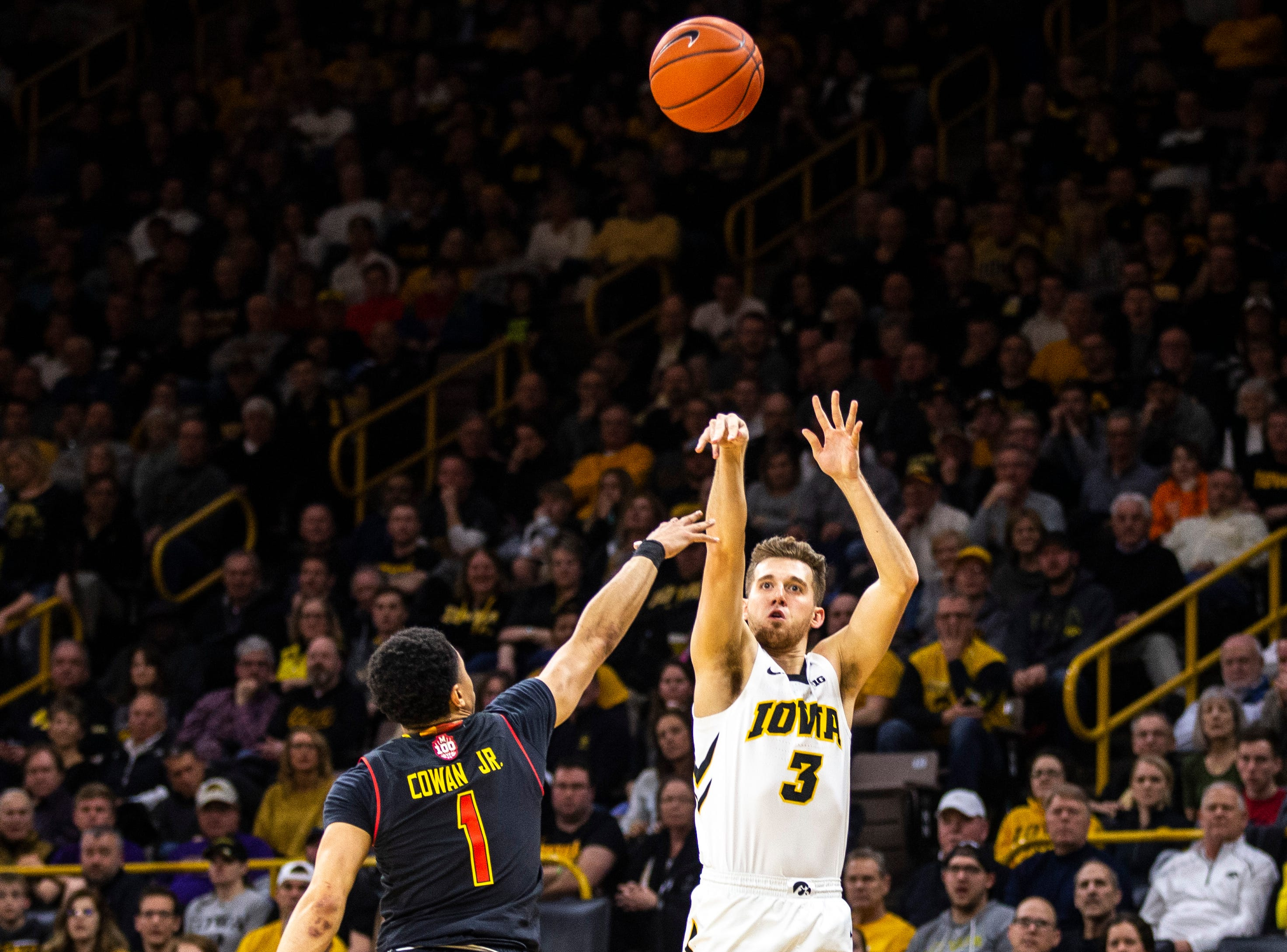 Iowa guard Jordan Bohannon (3) shoots a 3-point basket during a NCAA Big Ten Conference men's basketball game on Tuesday, Feb. 19, 2019 at Carver-Hawkeye Arena in Iowa City, Iowa.