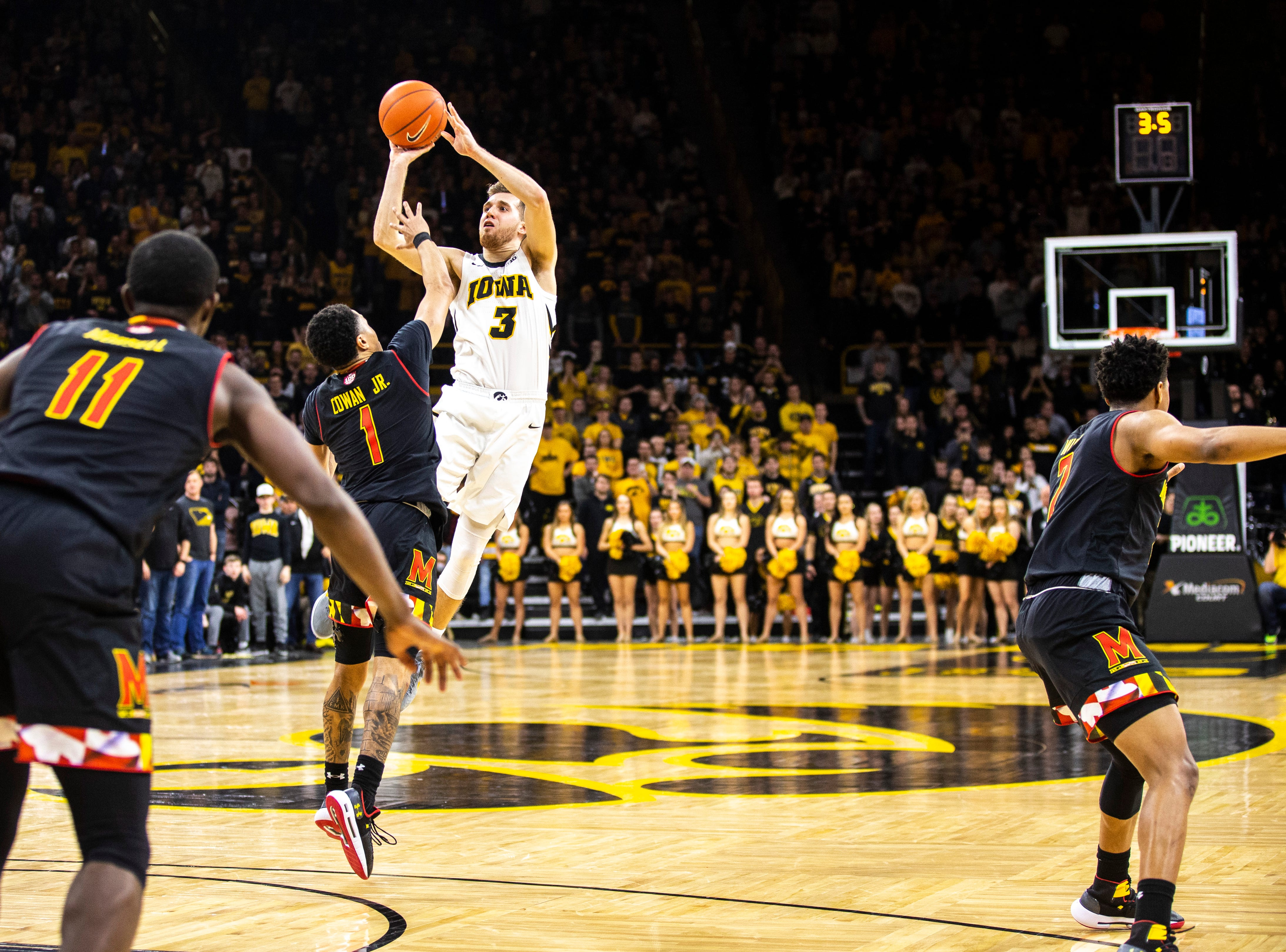 Iowa guard Jordan Bohannon (3) rises to shoot a basket while Maryland guard Anthony Cowan Jr. (1) defends during a NCAA Big Ten Conference men's basketball game on Tuesday, Feb. 19, 2019 at Carver-Hawkeye Arena in Iowa City, Iowa.