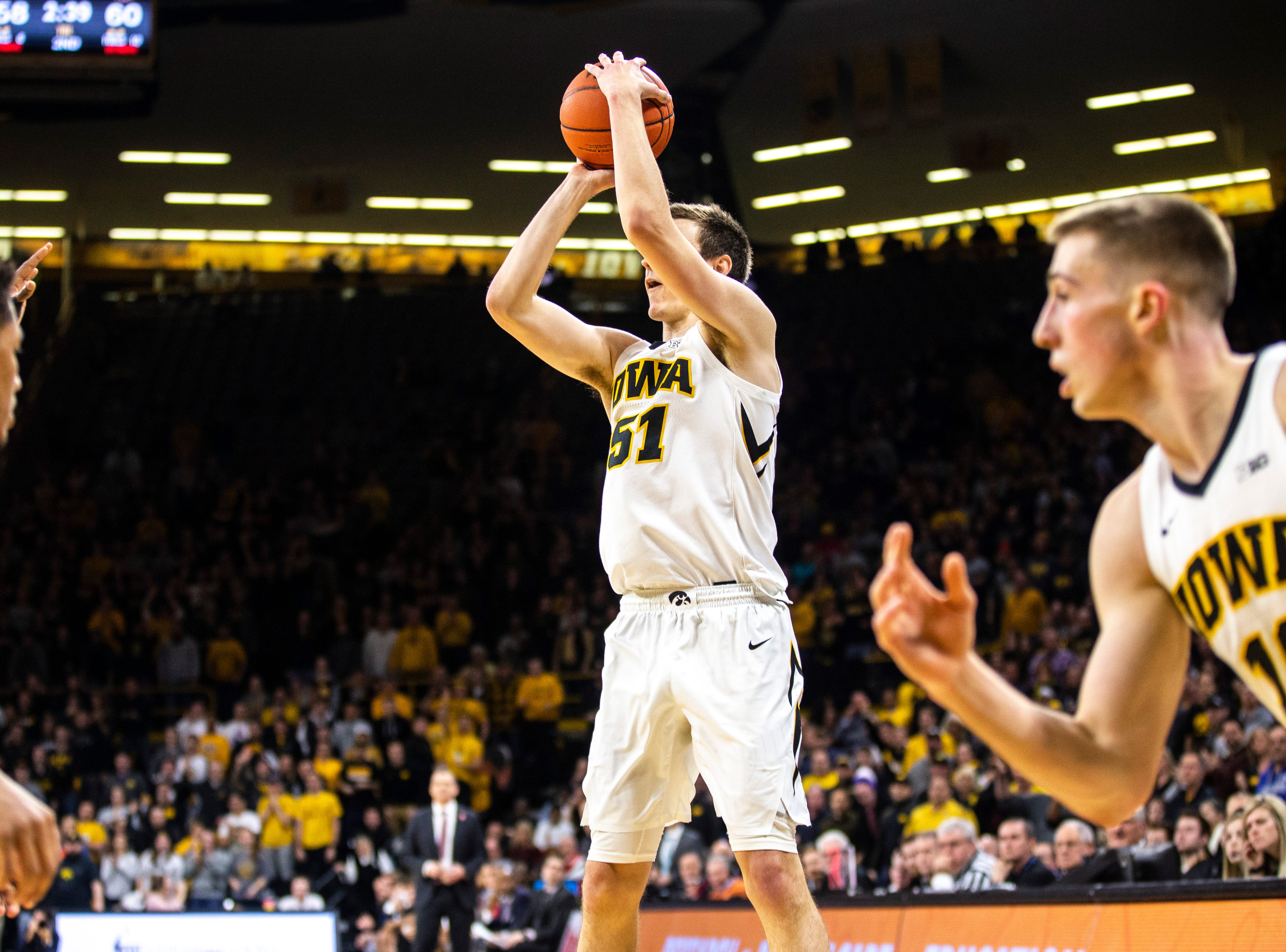 Iowa forward Nicholas Baer (51) shoots a 3-point basket during a NCAA Big Ten Conference men's basketball game on Tuesday, Feb. 19, 2019 at Carver-Hawkeye Arena in Iowa City, Iowa.