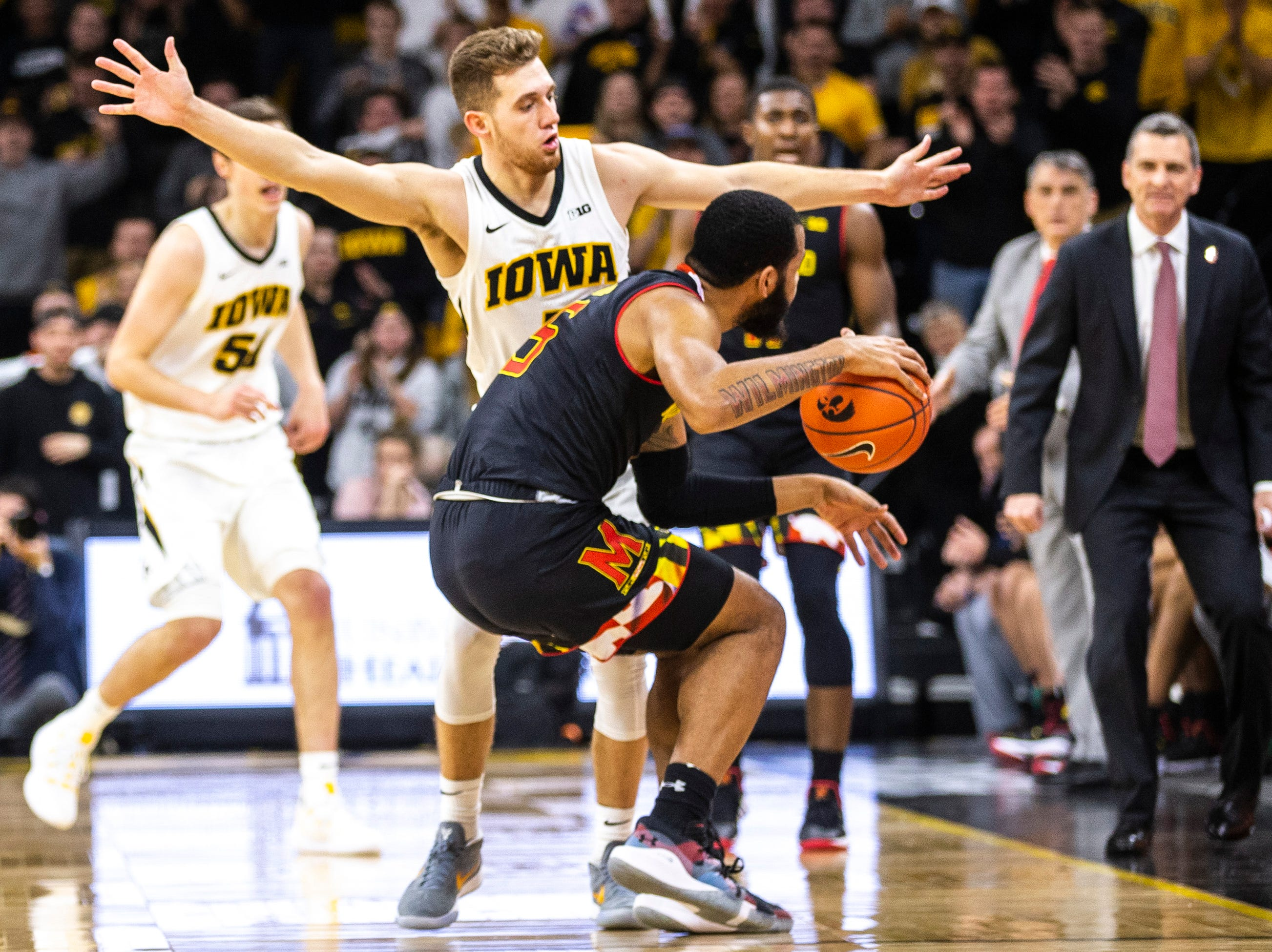 Iowa guard Jordan Bohannon (left) defends Maryland guard Eric Ayala (5) during a NCAA Big Ten Conference men's basketball game on Tuesday, Feb. 19, 2019 at Carver-Hawkeye Arena in Iowa City, Iowa.