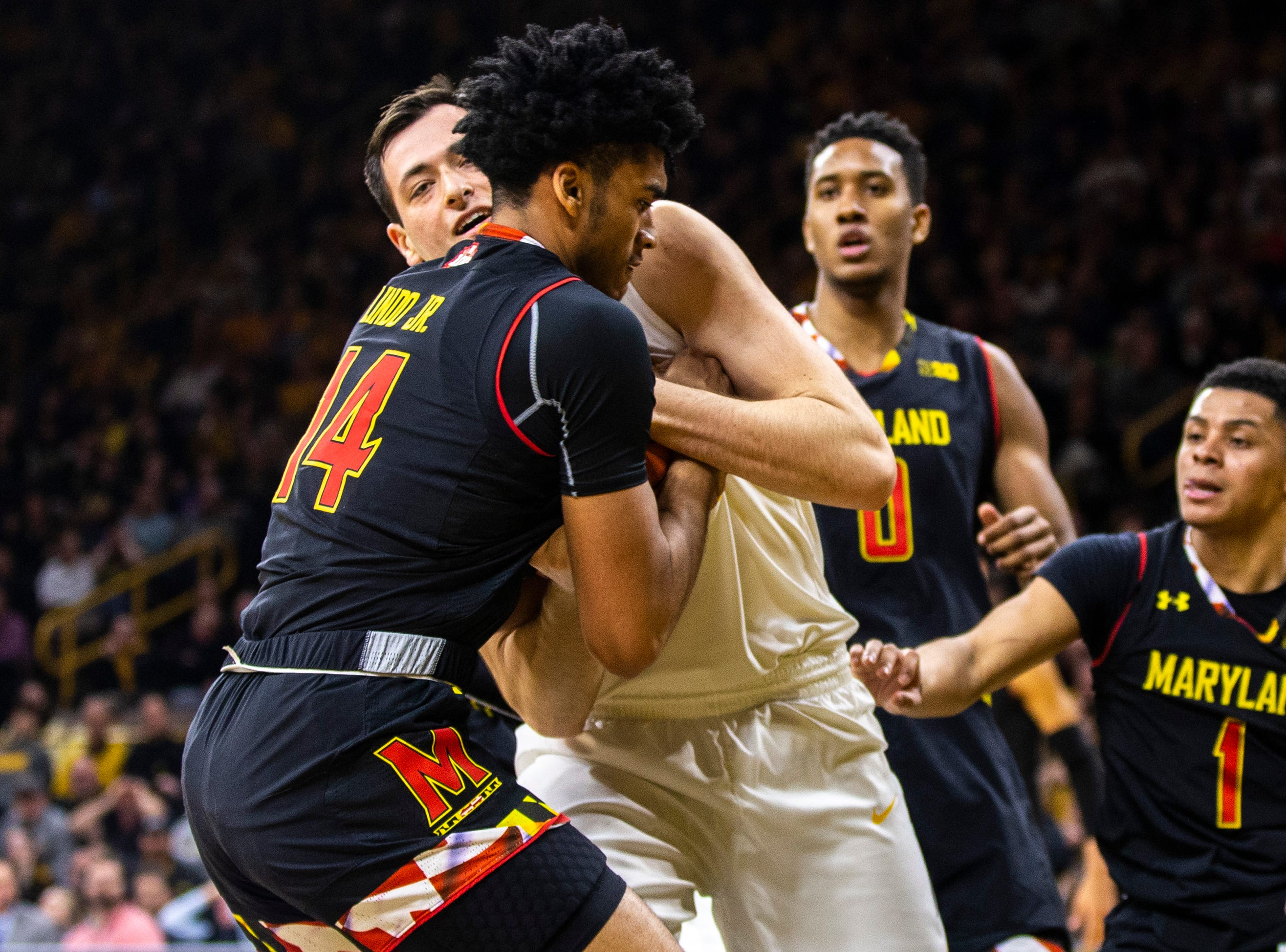 Iowa forward Ryan Kriener (15) battles Maryland forward Ricky Lindo Jr. (14) for a jump ball during a NCAA Big Ten Conference men's basketball game on Tuesday, Feb. 19, 2019 at Carver-Hawkeye Arena in Iowa City, Iowa.