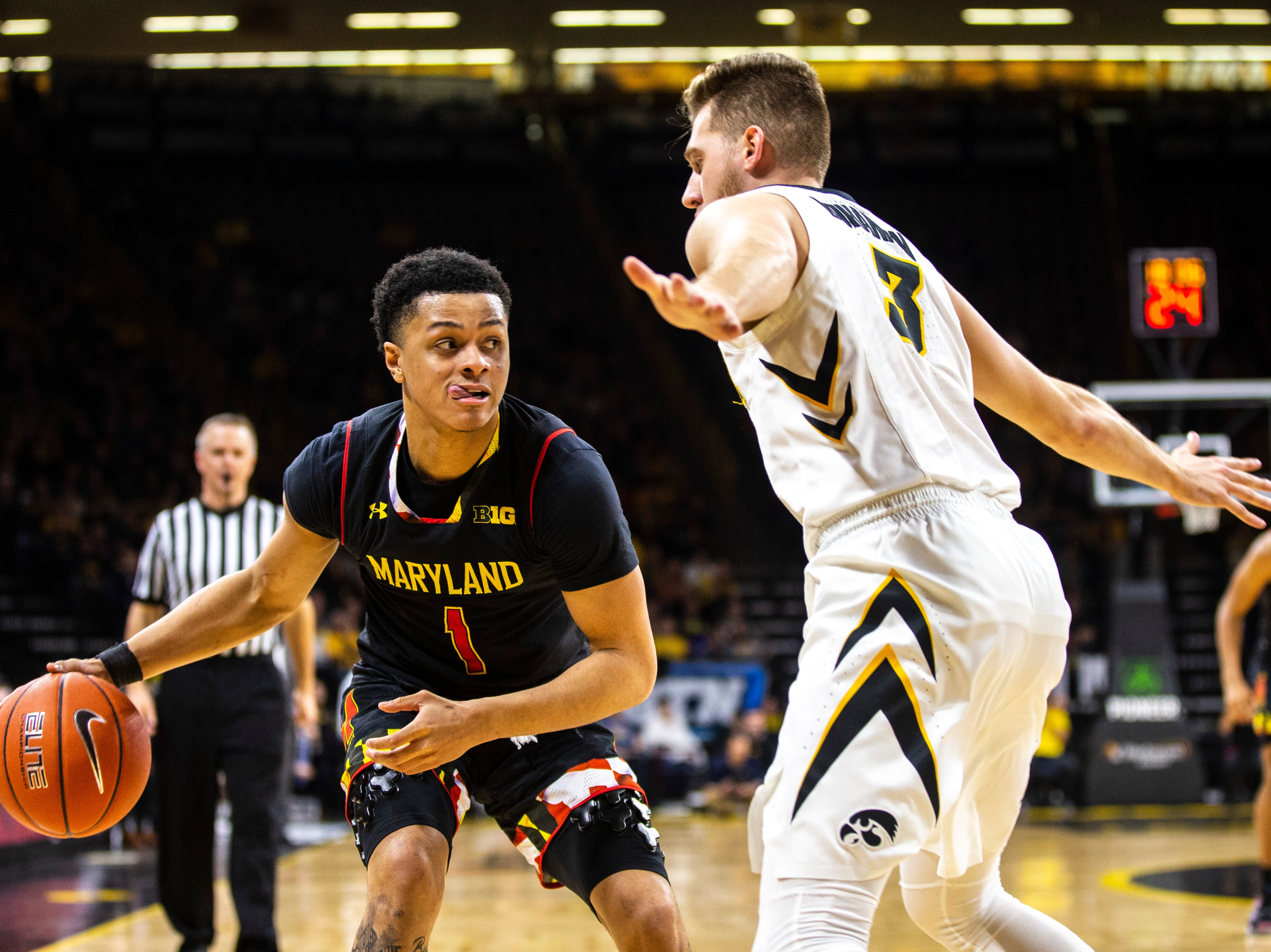 Maryland guard Anthony Cowan Jr. (1) takes the ball up court while Iowa guard Jordan Bohannon (3) defends during a NCAA Big Ten Conference men's basketball game on Tuesday, Feb. 19, 2019 at Carver-Hawkeye Arena in Iowa City, Iowa.