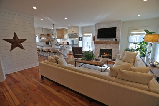 The living room, with a fireplace, connects to the kitchen in an open flow first floor, at 7349 N. Pennsylvania St. in Meridian Hills, Friday, Feb. 15, 2019.