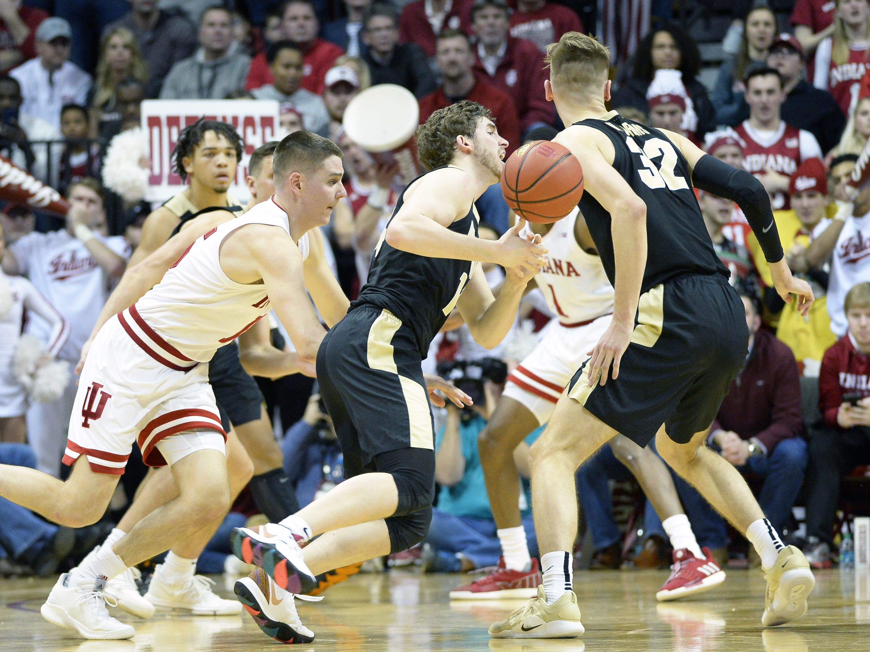 Purdue Boilermakers guard Ryan Cline (14) looses the ball during the Indiana-Purdue game at Simon Skjodt Assembly Hall in Bloomington, Ind., on Tuesday, Feb. 19, 2019.