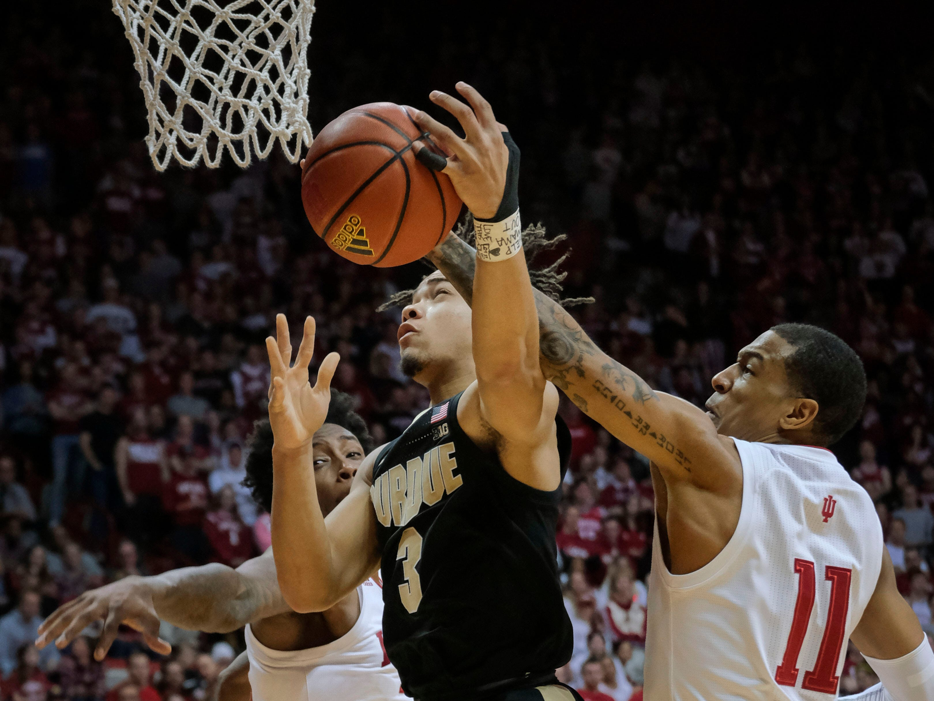Purdue guard Carsen Edwards (3) tries to shoot as Indiana guard Devonte Green (11) defends during the first half of an NCAA college basketball game in Bloomington, Ind., Tuesday, Feb. 19, 2019.