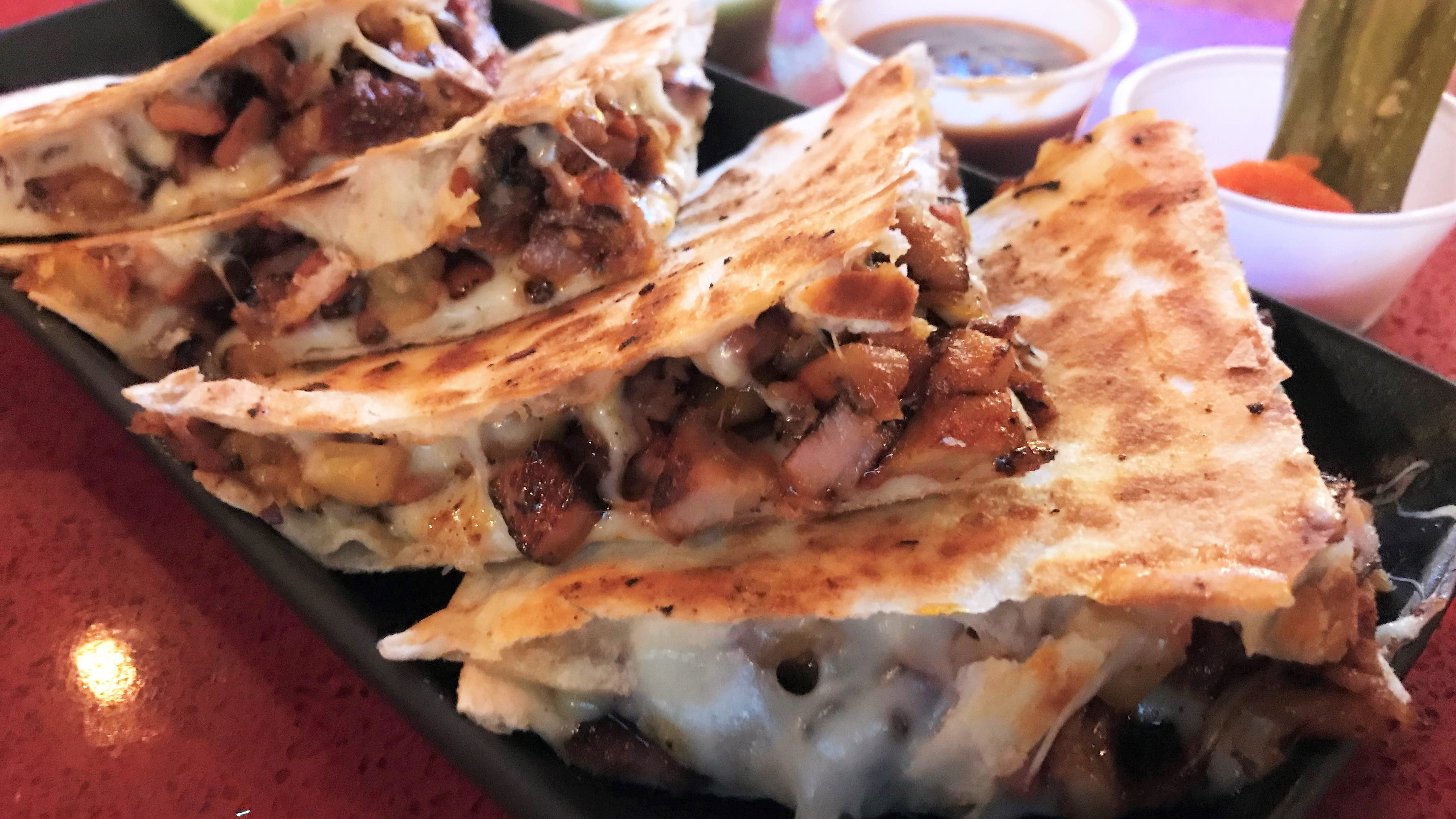 Al pastor, grilled steak, cubed ham, bacon, tangy pineapple and melted cheese fill the Gringa Especial at Samano's Taqueria & Mexican Restaurant in Fishers on opening day Feb. 19, 2019.