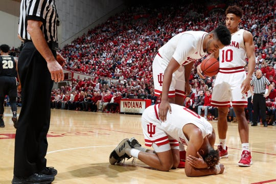Hoosiers forward Juwan Morgan (13) checks on guard Romeo Langford (0) after falling on the court against the Purdue Boilermakers during the second half at Assembly Hall.