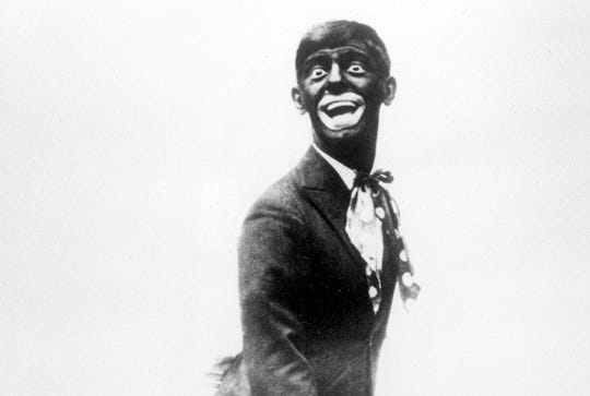 This 1920s image shows comedian Eddie Cantor wearing blackface while performing.