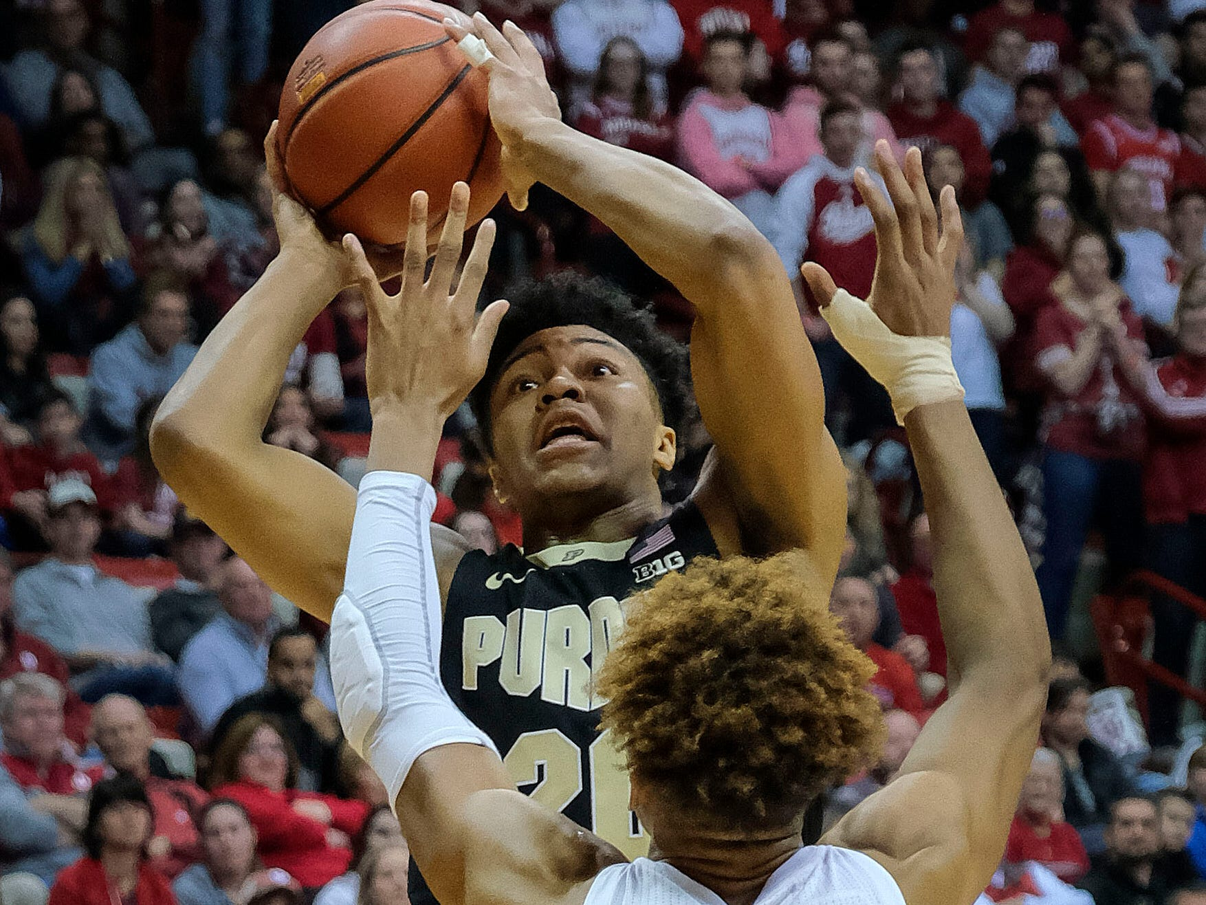Purdue guard Nojel Eastern, rear, shoots over Indiana guard Romeo Langford during the first half of an NCAA college basketball game in Bloomington, Ind., Tuesday, Feb. 19, 2019. (AP Photo/AJ Mast)