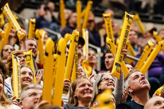 """Fans wave boom sticks during a game between the Pacers and Hornets in January. """"The Downtown Indianapolis we know and love wouldn't exist without the Pacers,"""" writes Gregg Doyel."""