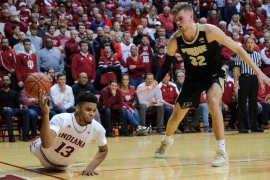 Indiana forward Juwan Morgan (13) loses a ball out of bounds in front of Purdue center Matt Haarms (32) during the second half of an NCAA college basketball game in Bloomington, Ind., Tuesday, Feb. 19, 2019. Purdue won 48-46.